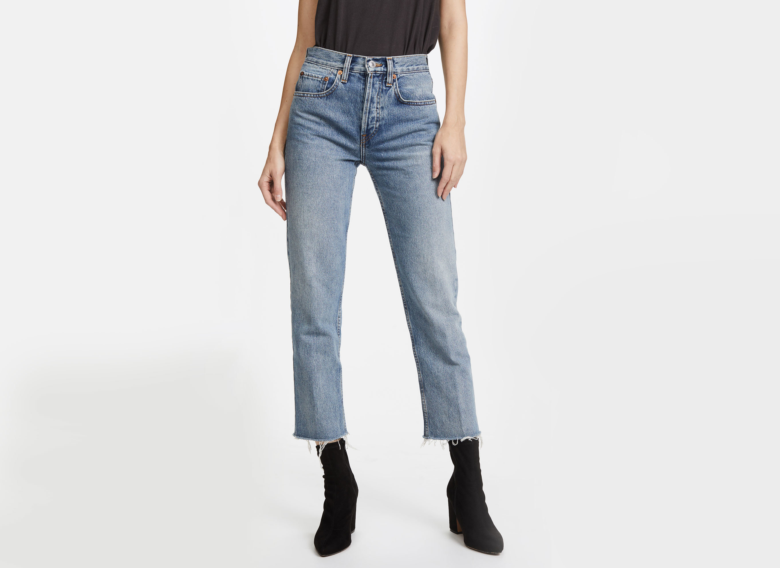 Travel Shop Travel Trends person jeans denim clothing wearing trouser trousers waist pocket posing