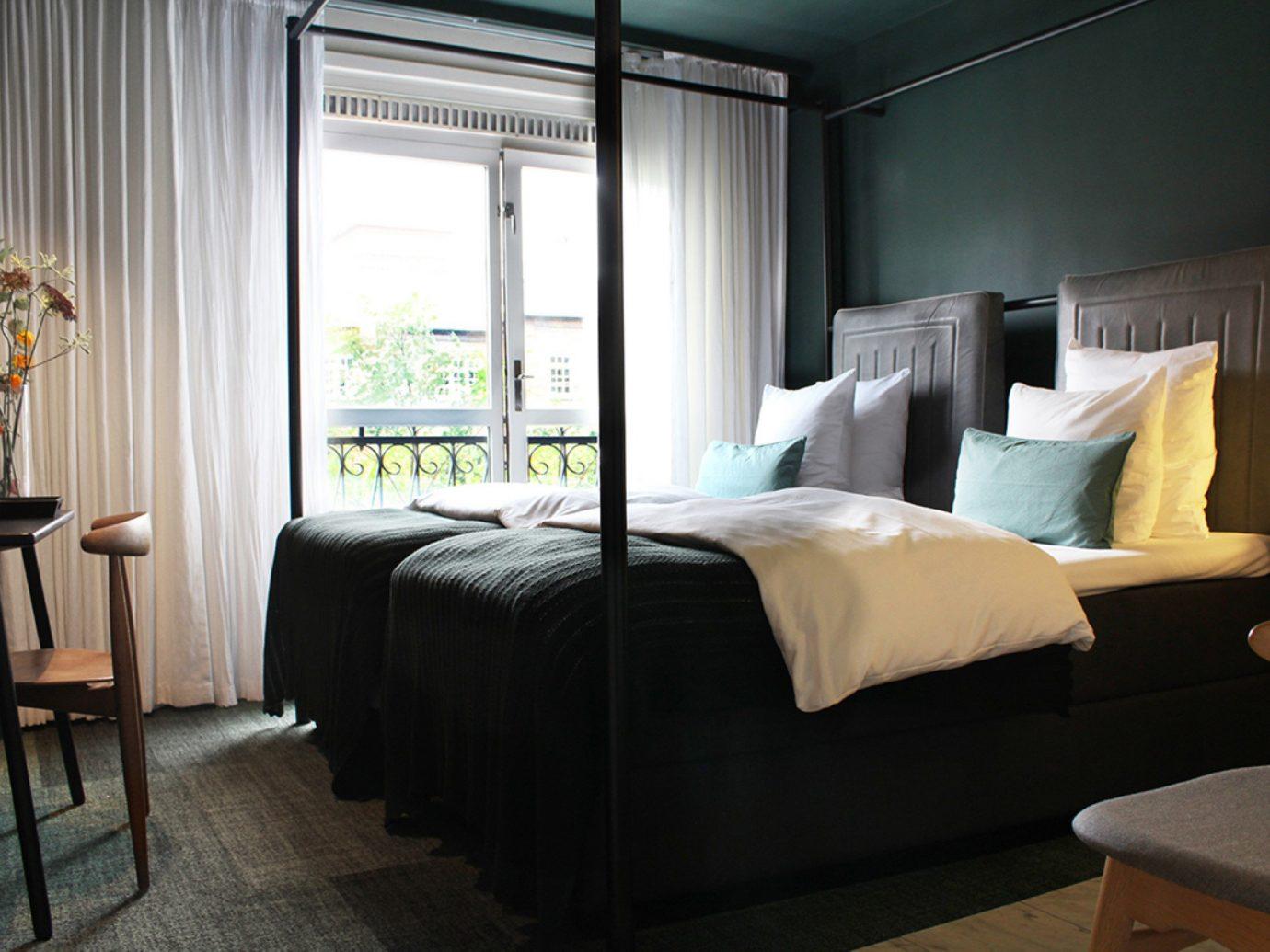 Boutique Hotels Copenhagen Denmark Hotels indoor floor wall bed hotel room chair Bedroom bed frame interior design desk Suite furniture mattress ceiling window lamp