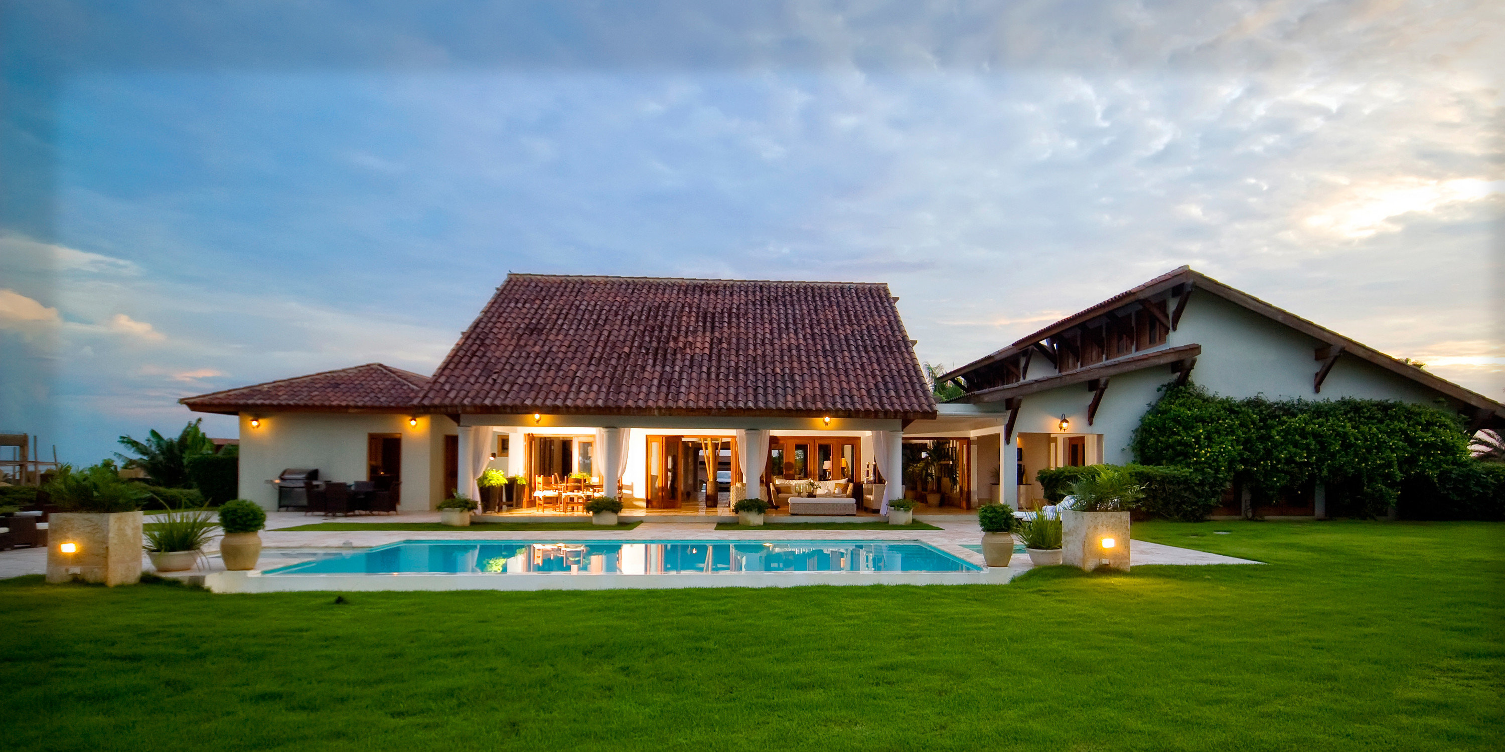 Hotels grass sky outdoor house property estate home Resort building vacation green residential area Villa real estate cottage mansion farmhouse hacienda sign
