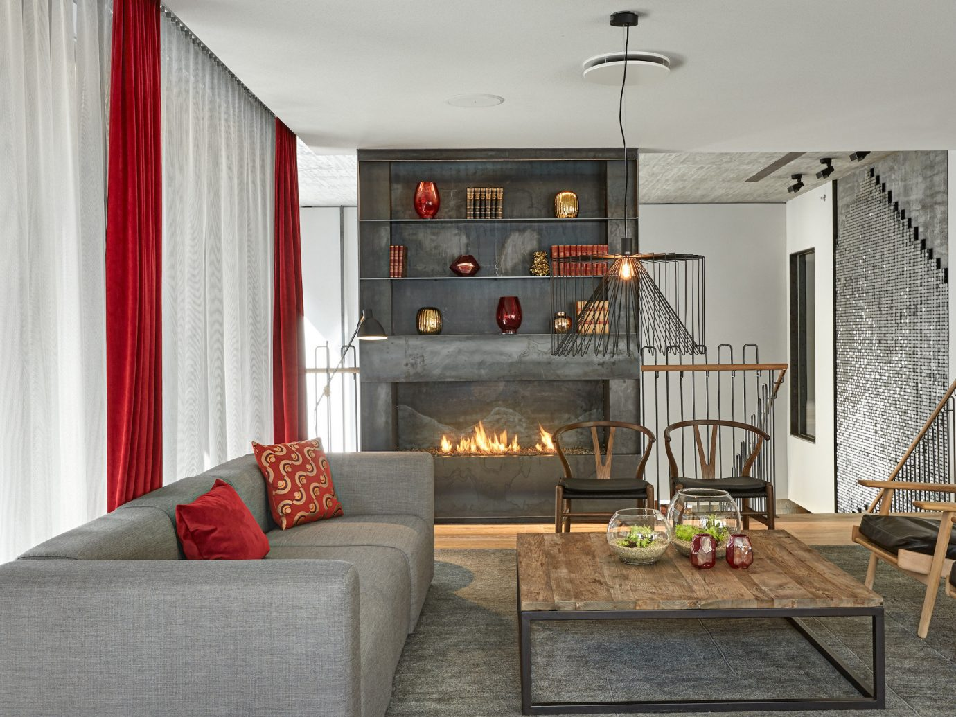 Boutique Hotels indoor Living room wall sofa floor chair living room property home interior design red cottage furniture Design real estate loft estate farmhouse apartment decorated