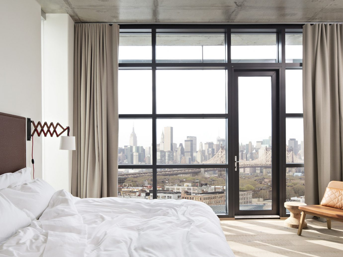 bed Bedroom Boutique chic City city views contemporary Hip Hotels interior Luxury Modern natural light neutral tones Style + Design trendy view window indoor room property hotel interior design floor curtain furniture pillow living room home window covering wood window treatment textile ceiling