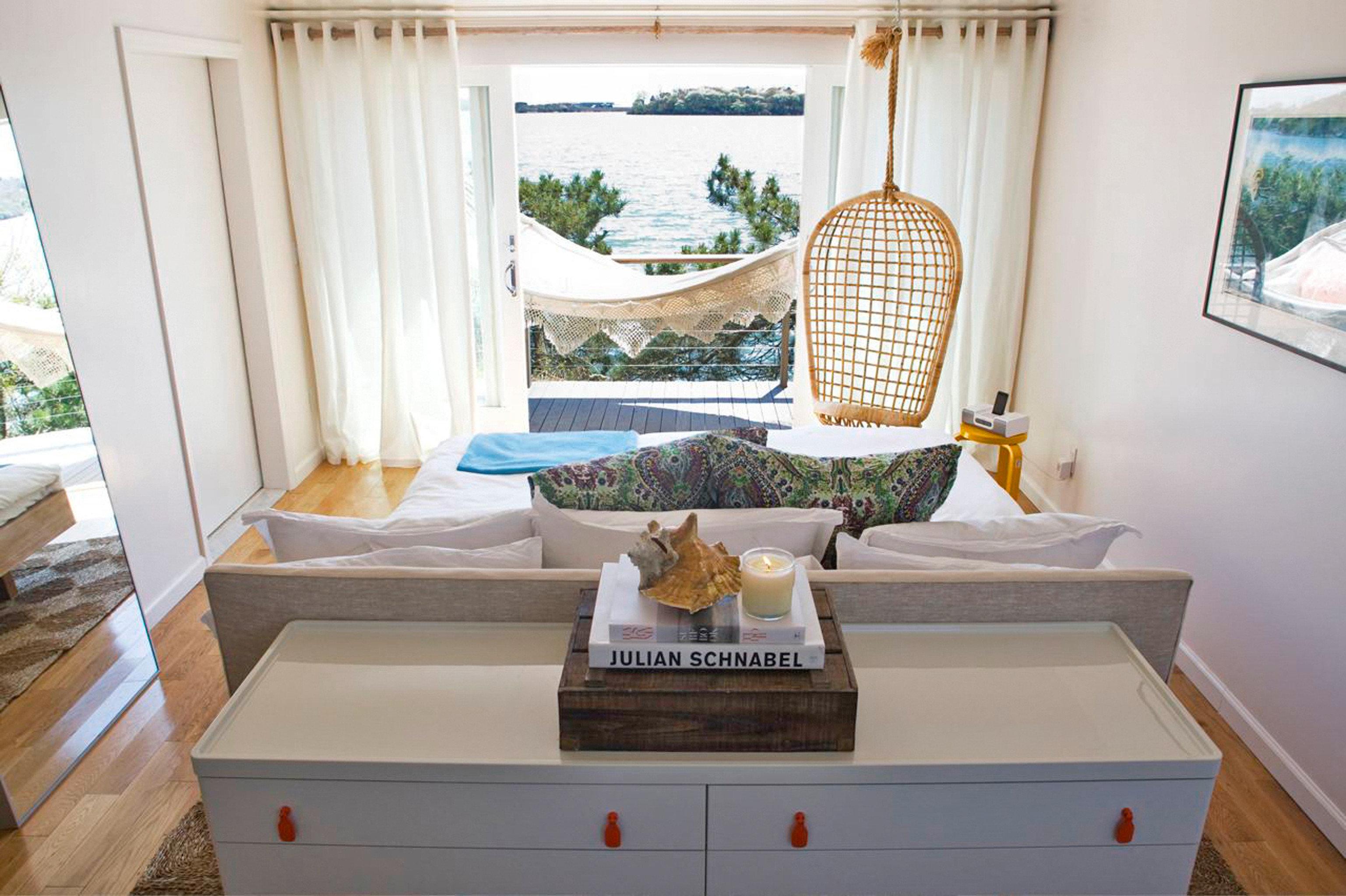 Beach Hotels Romance Solo Travel Trip Ideas Weekend Getaways room property home house estate cottage interior design living room furniture real estate Design