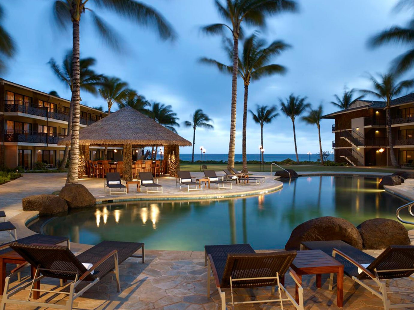 Bar Deck Exterior Honeymoon Hotels Island Luxury Outdoors Pool Resort Romance Romantic outdoor sky chair tree property lawn estate vacation swimming pool home condominium real estate Villa lined set several swimming