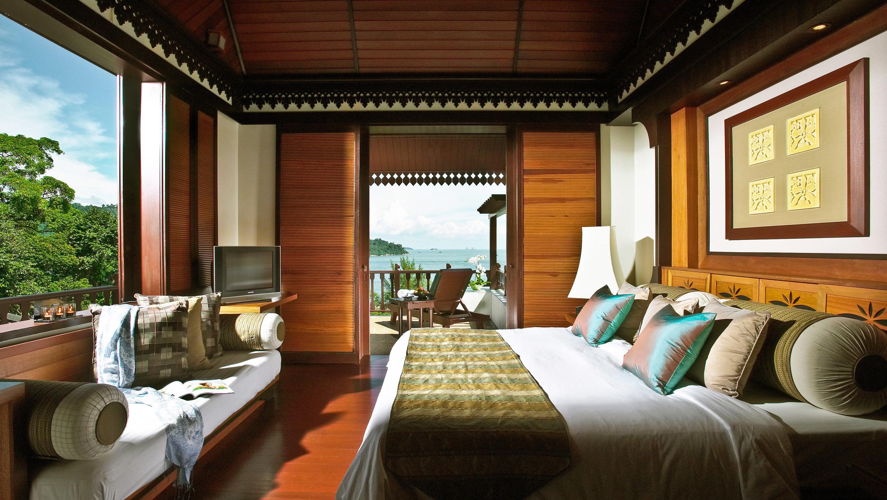 Hotels indoor sofa window room bed property estate ceiling Resort Suite home interior design hotel living room cottage Villa real estate furniture Bedroom