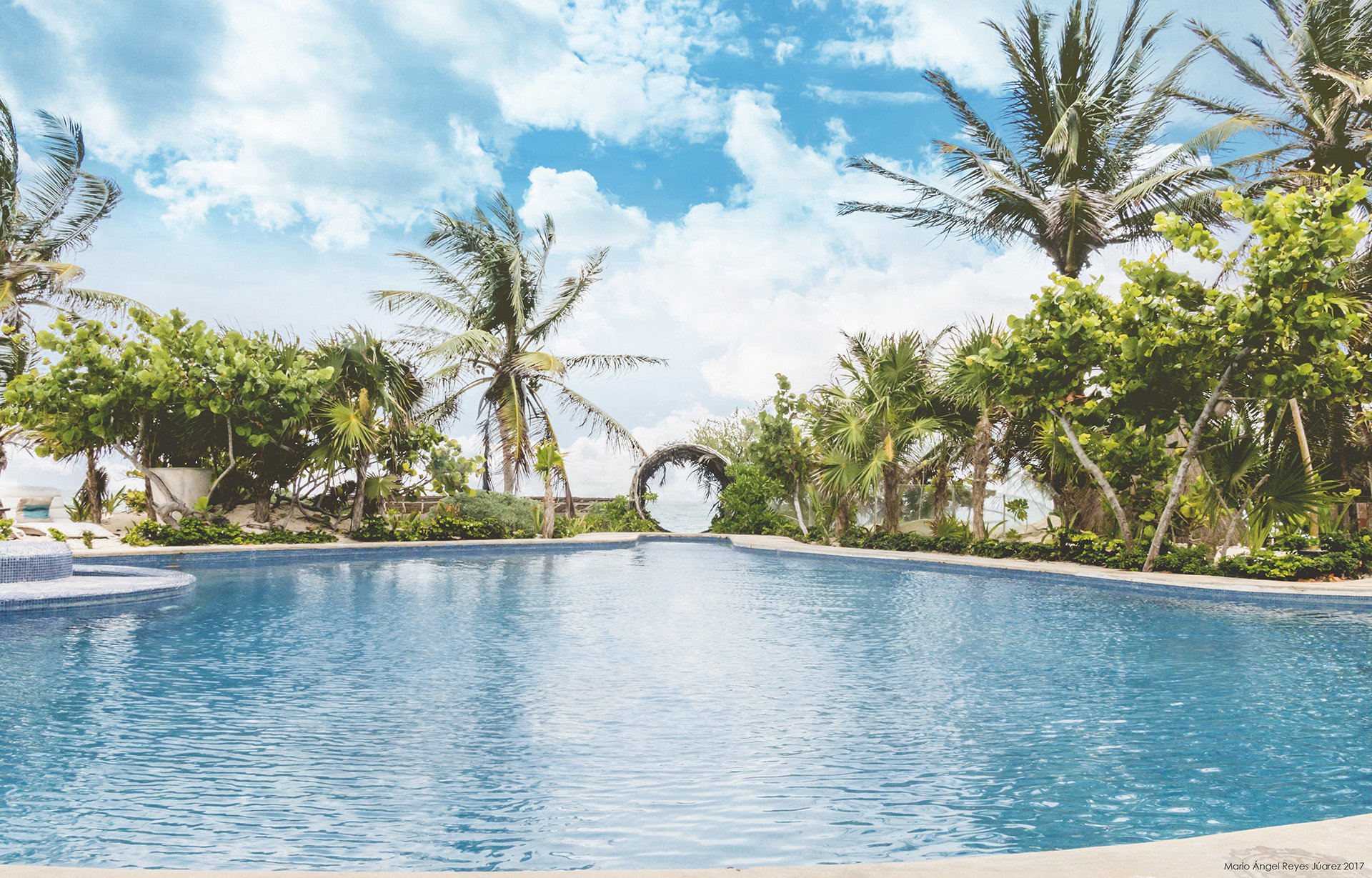 Boutique Hotels Hotels Mexico Tulum swimming pool Resort property water sky tropics arecales palm tree tree leisure caribbean Sea Lagoon vacation real estate tourism estate resort town bay plant computer wallpaper