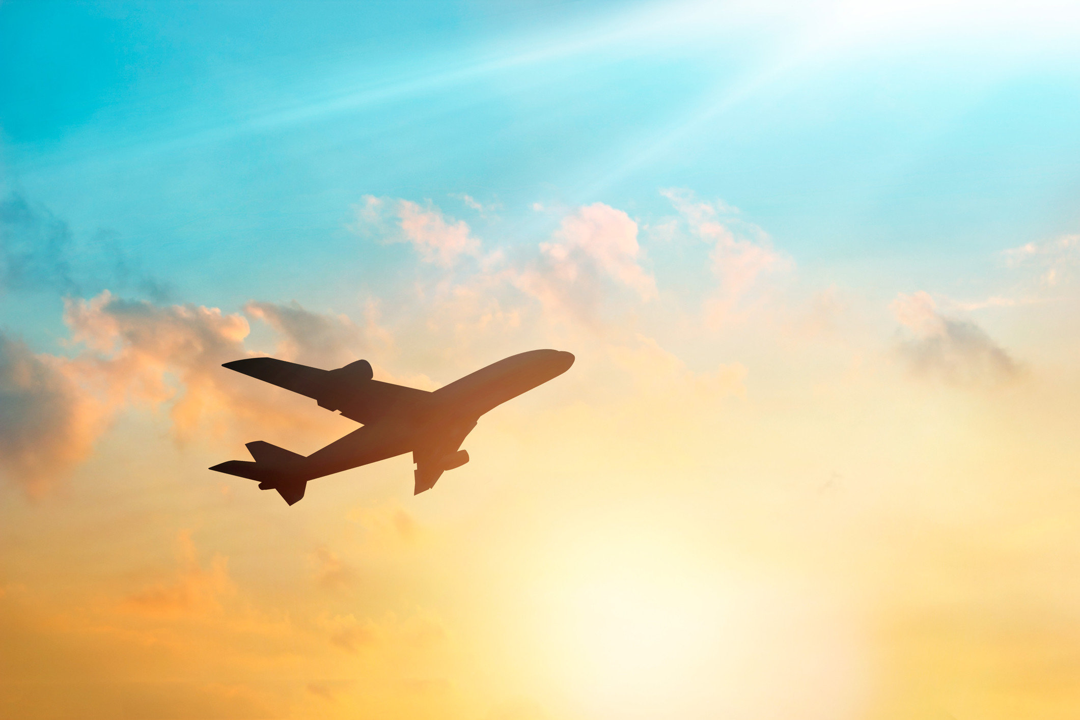Flights Travel Tips sky outdoor flying plane airplane Sunset air travel aircraft flight clouds aviation atmosphere daytime atmosphere of earth airline jet aerospace engineering cloudy cloud transport airliner air sunlight wing computer wallpaper meteorological phenomenon sunrise afterglow dawn narrow body aircraft dark day
