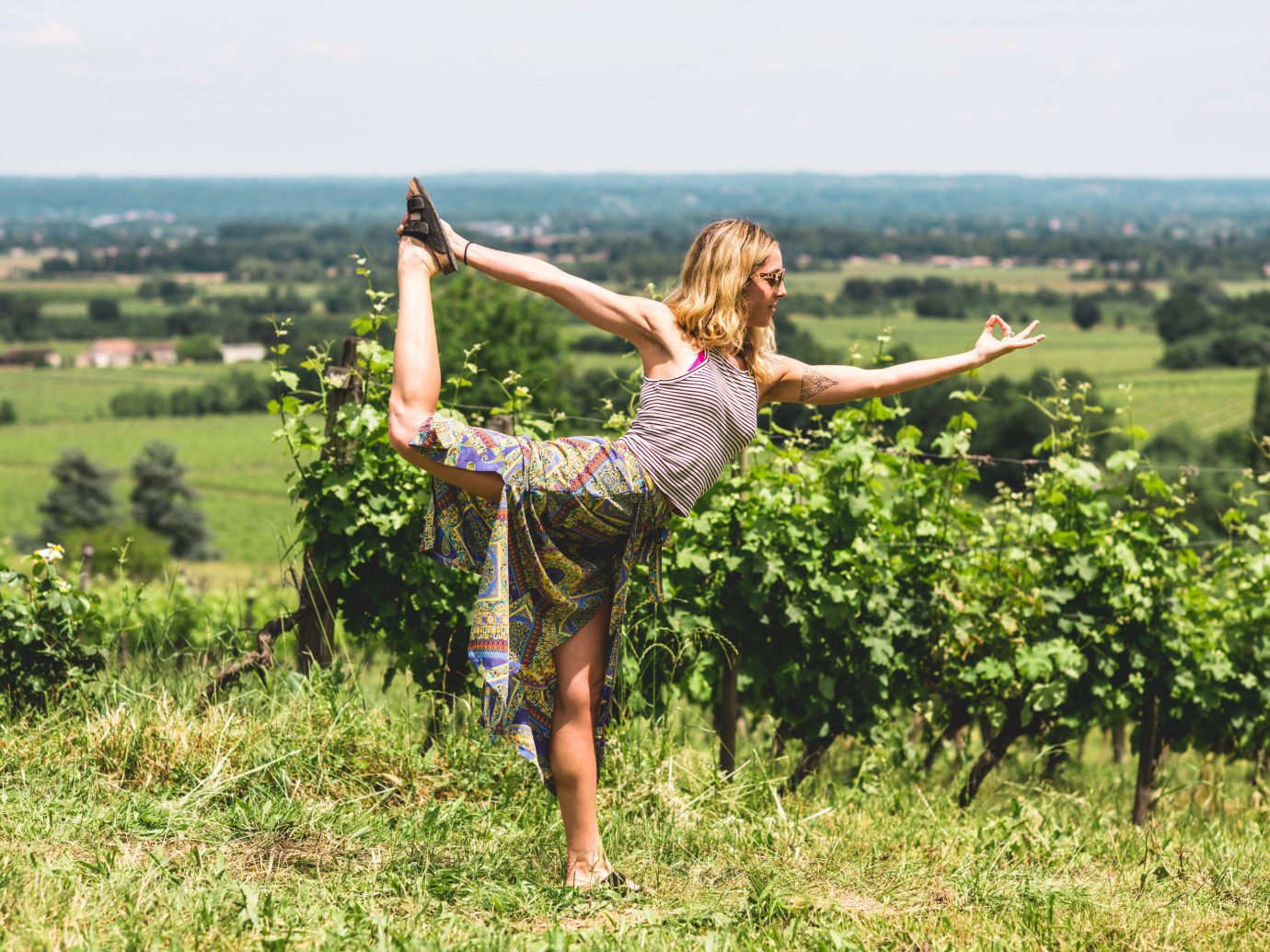 Health + Wellness Meditation Retreats Trip Ideas Yoga Retreats grass outdoor field agriculture meadow sports physical fitness green lawn flower jumping lush
