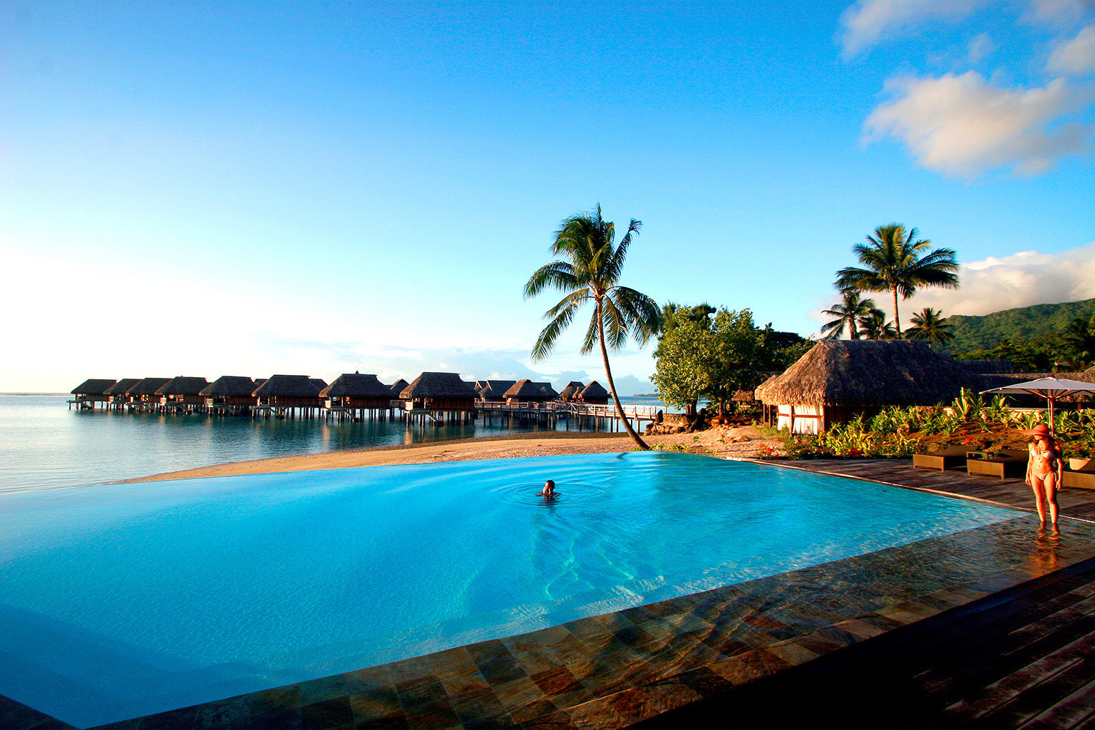 All-Inclusive Resorts Boutique Hotels Hotels Luxury Overwater Bungalow Play Pool Resort Romance Scenic views Trip Ideas sky water outdoor Boat swimming pool leisure scene vacation Sea Ocean estate Beach bay caribbean Lagoon arecales blue shore swimming Island