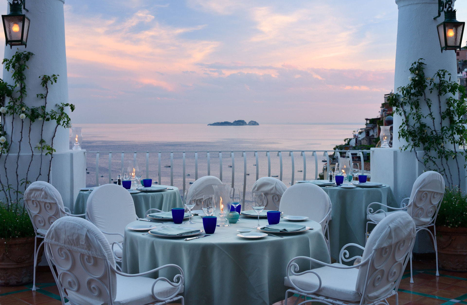 calm dawn Dining dusk europe Hotels Island Ocean ocean view outdoor dining Patio private dining remote serene table Terrace restaurant vacation estate Resort Villa
