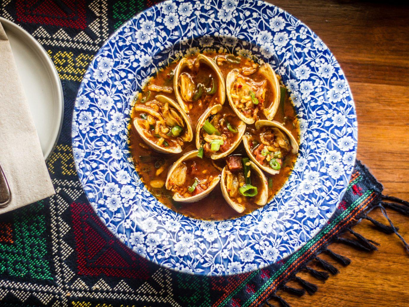 Food + Drink table plate food indoor floor art produce flower blue pattern meal vegetable