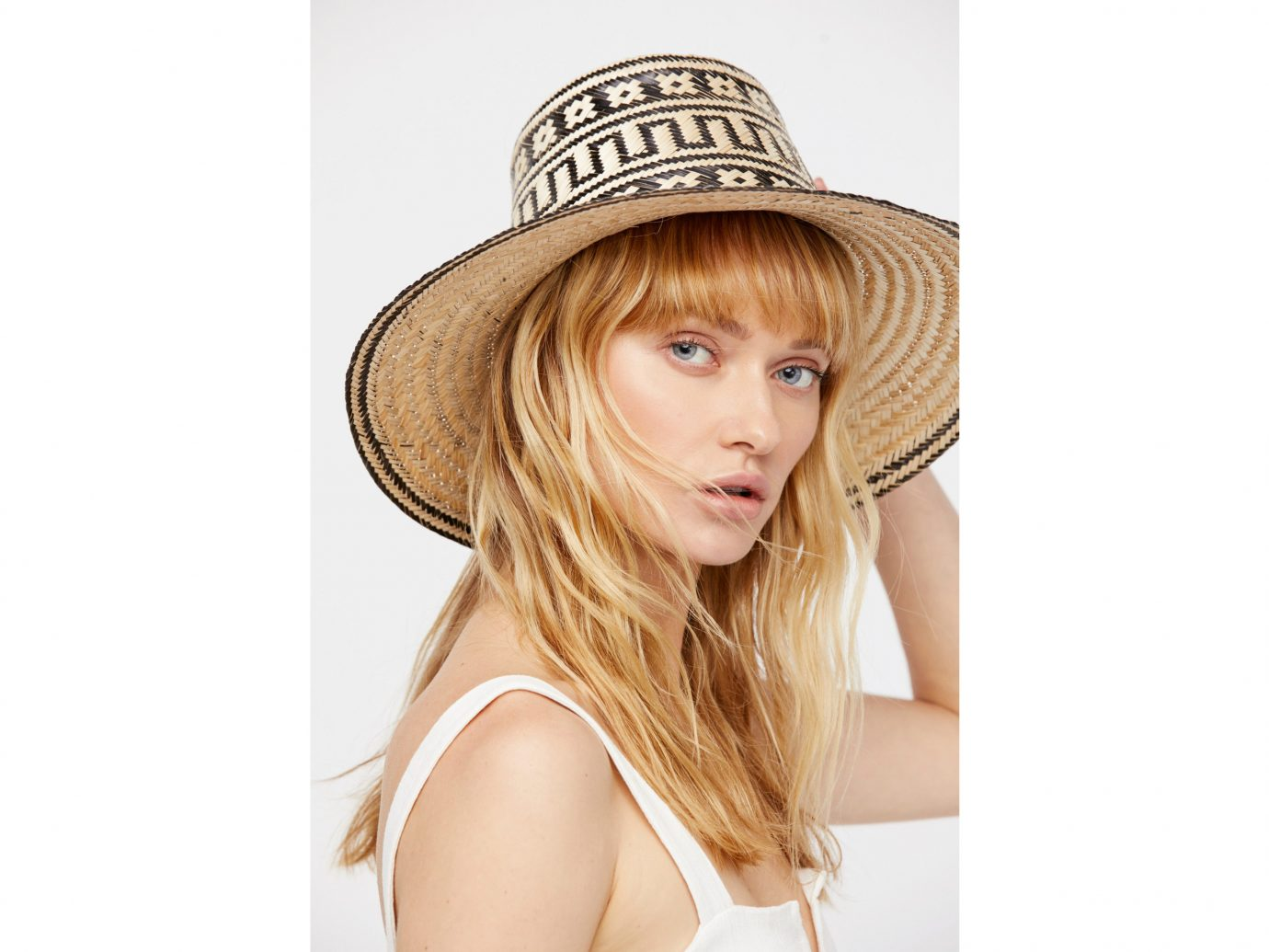 Style + Design person wearing human hair color hat young headgear sun hat fashion accessory blond fedora posing fashion model beige brown hair hair coloring beautiful dressed