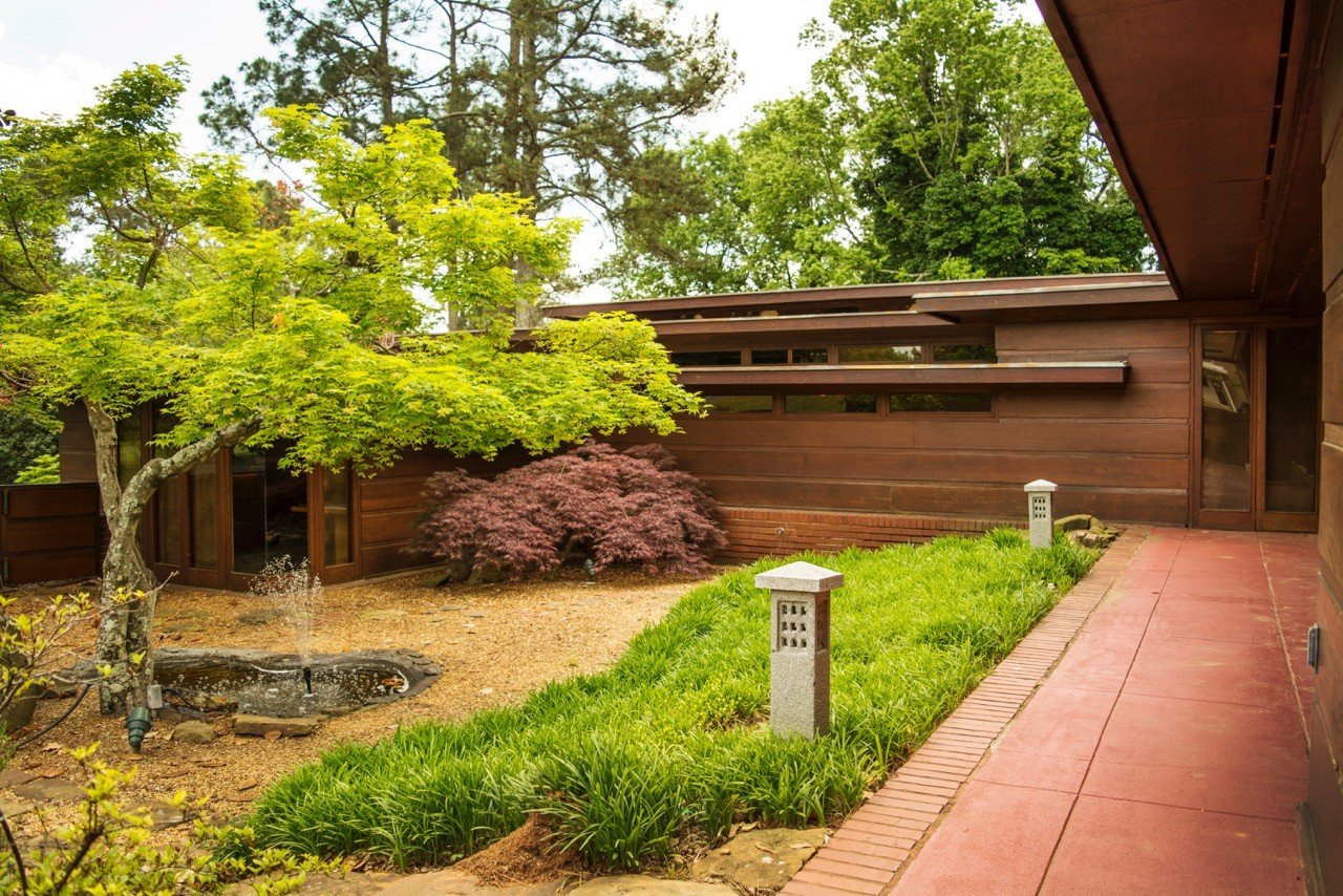 Architecture building calm Exterior Garden grass Greenery Nature park remote Rustic serene trees Trip Ideas tree outdoor yard backyard house plant estate home flower Courtyard real estate outdoor structure lawn landscape architect shrub landscaping stone walkway