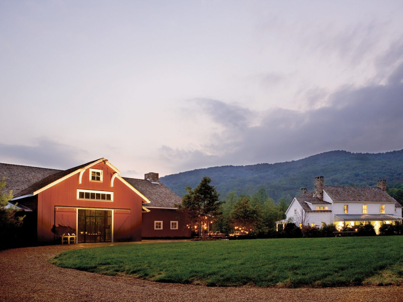 All-Inclusive Resorts Classic Country Grounds Hotels Luxury Romance Scenic views Trip Ideas sky outdoor grass mountain house building estate rural area cloud hill morning farm building landscape mountain range home Farm evening barn hillside