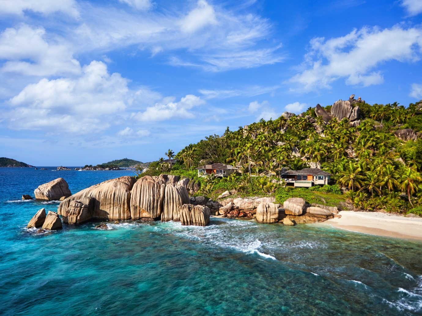 Hotels sky outdoor water Sea geographical feature landform Coast Beach Ocean shore vacation Nature bay islet cove Island caribbean tropics cape Lagoon terrain rock