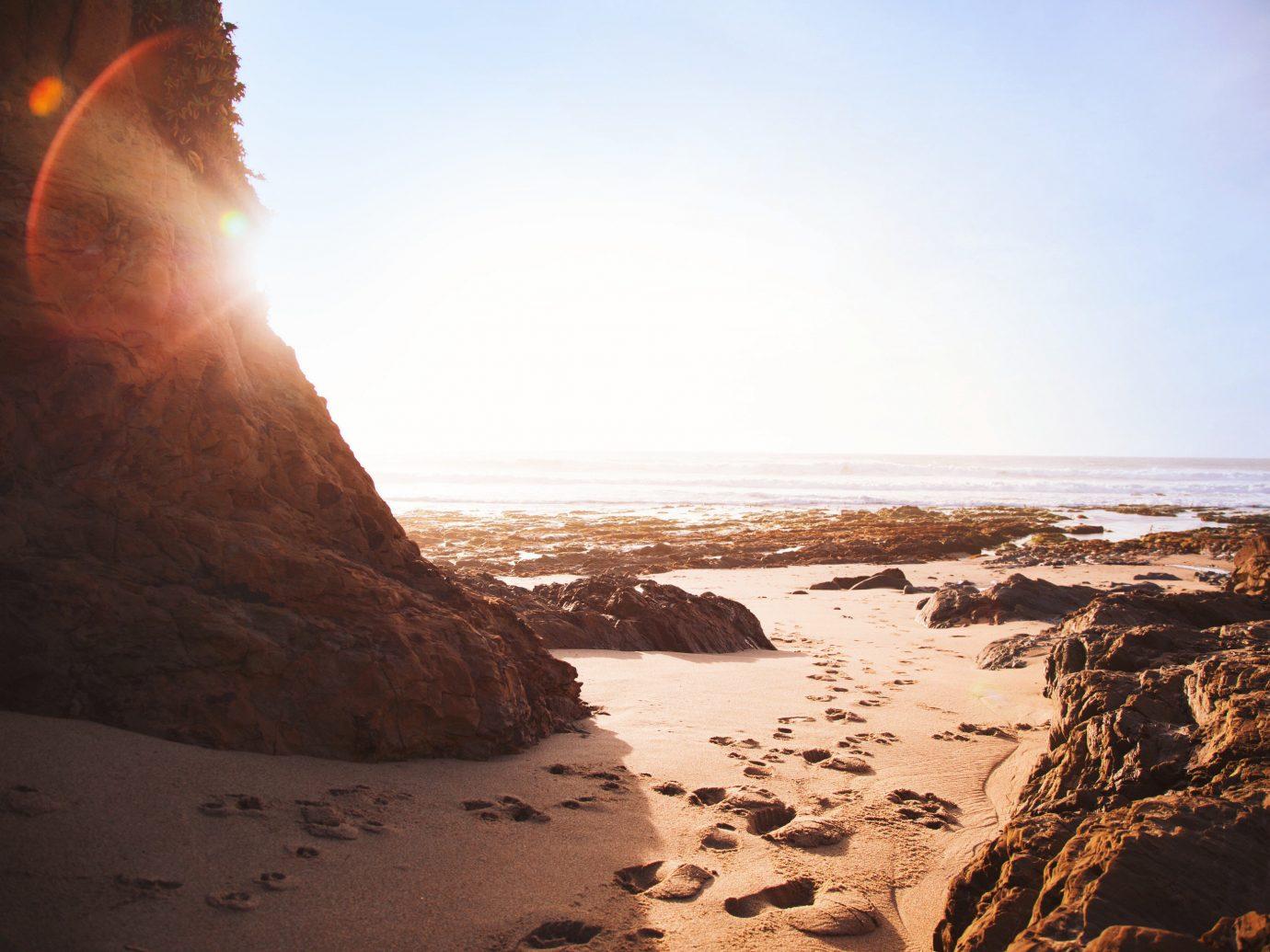 outdoor sky Nature Sea Coast body of water Ocean Beach shore rock wave morning sand wind wave sunlight Sunset cliff terrain material sunrise cape day