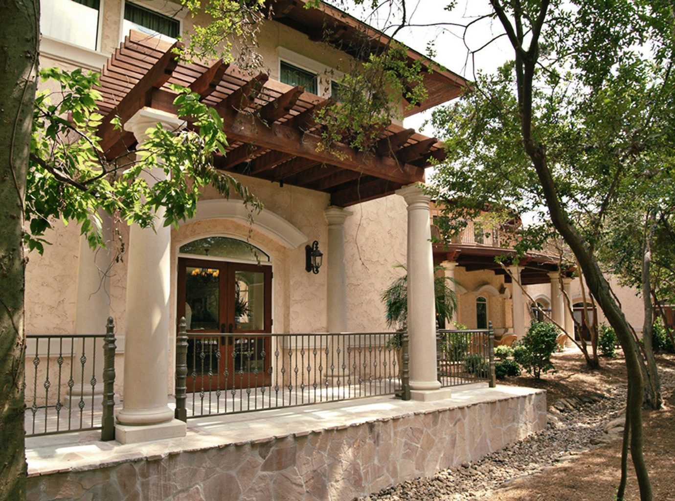 Elegant Exterior Jetsetter Guides Rustic tree outdoor ground property building house neighbourhood estate home Courtyard mansion Resort shrine hacienda Village temple outdoor structure Villa stone