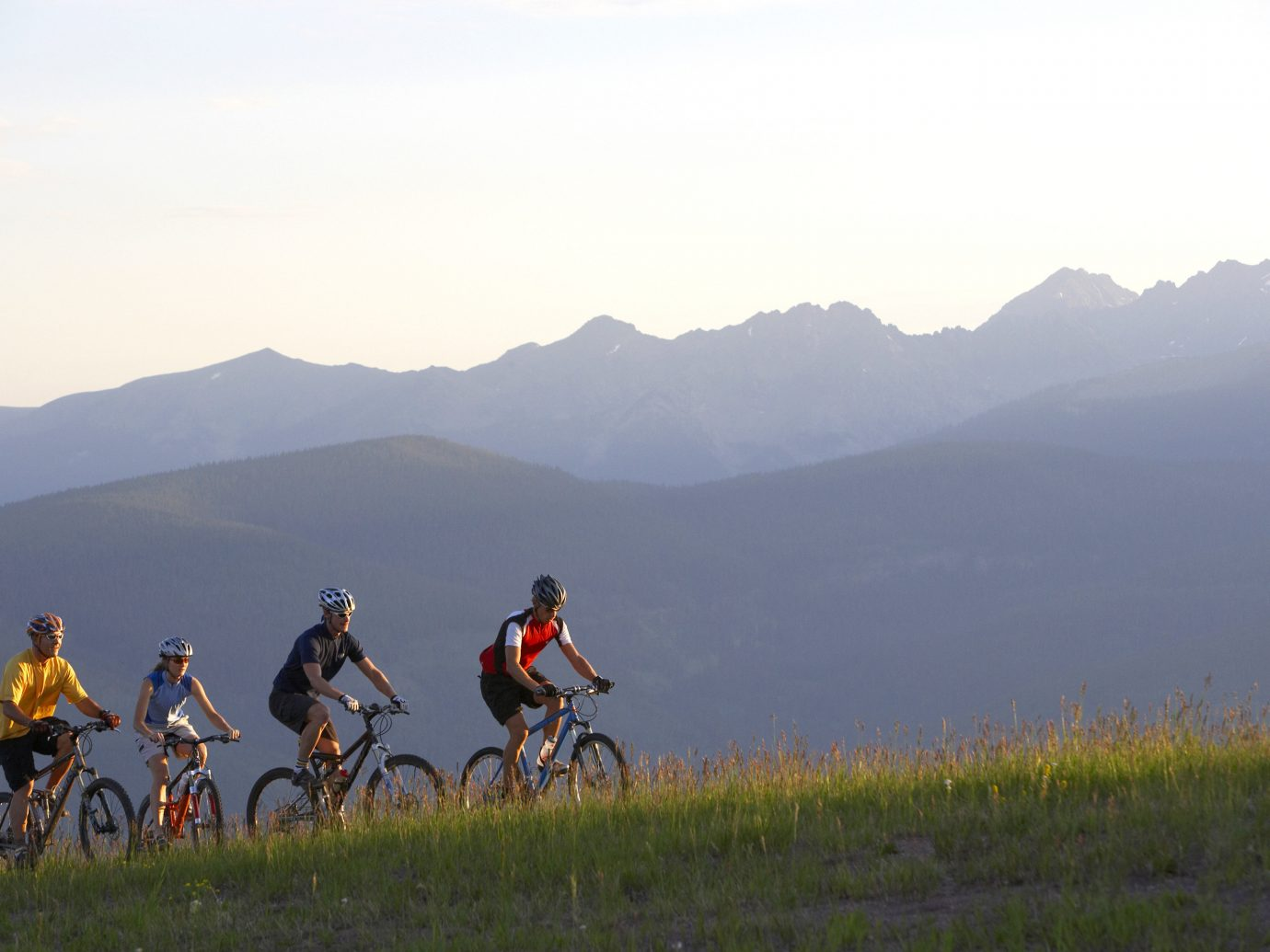Mountains + Skiing Outdoors + Adventure grass sky outdoor mountain mountainous landforms mountain bike mountain biking bicycle cycle sport cycling mountain range vehicle sports ridge extreme sport freeride grassy