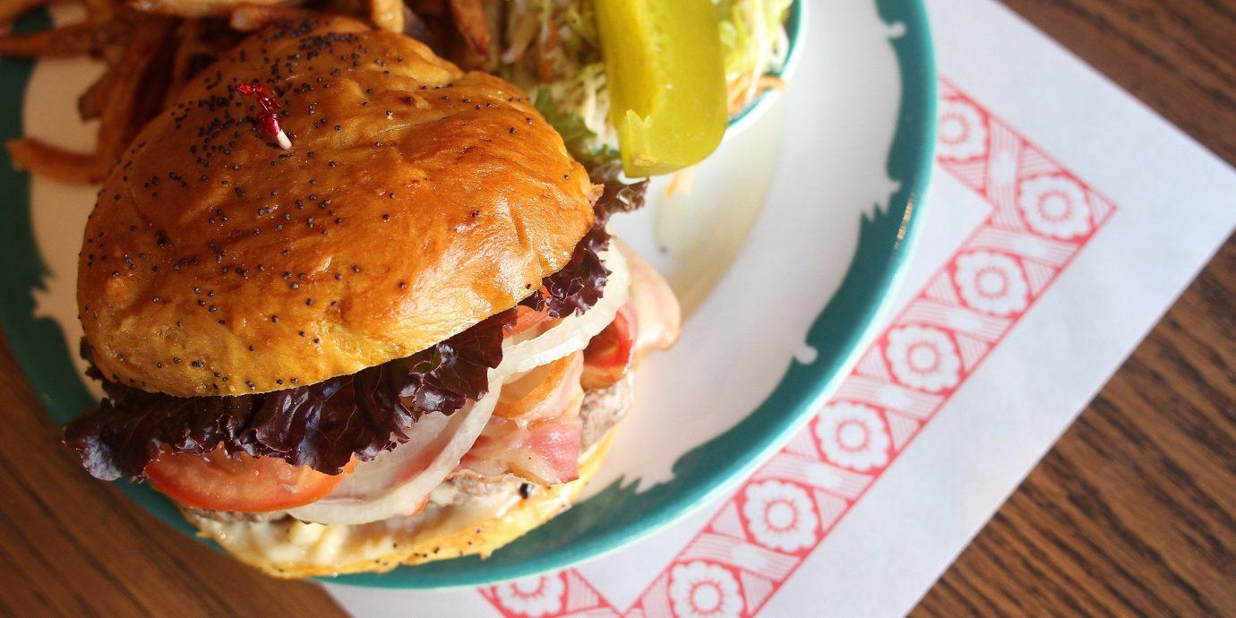 Food + Drink table food plate dish hamburger indoor sandwich snack food meal meat breakfast slider produce pulled pork