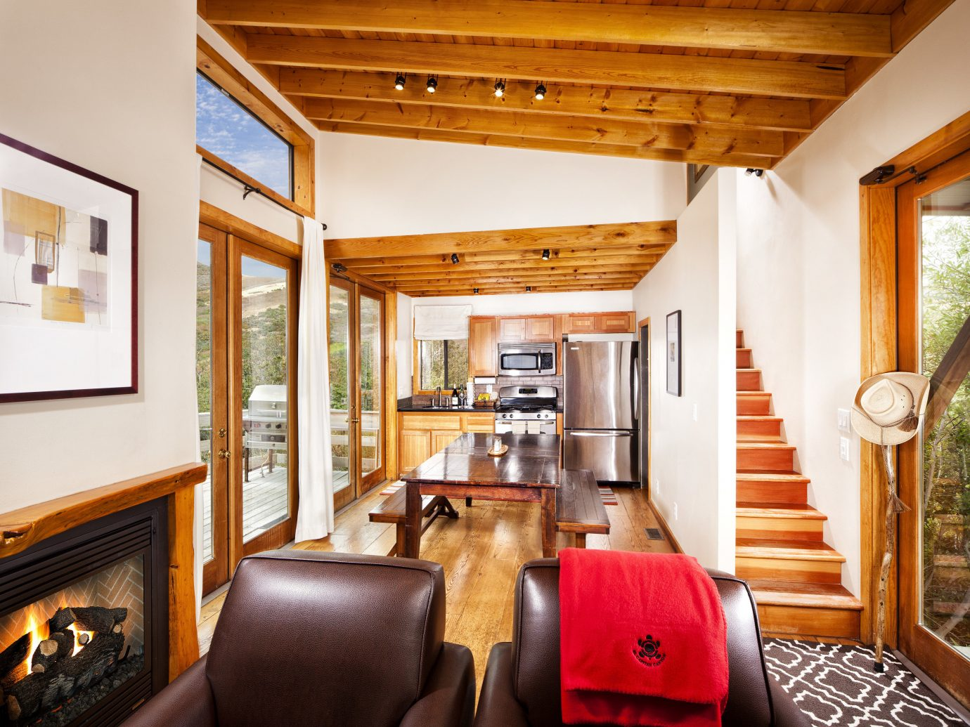 Boutique Hotels Fall Travel Hotels Outdoors + Adventure indoor wall ceiling room Living property estate home house living room cottage real estate interior design furniture farmhouse Suite Bedroom leather