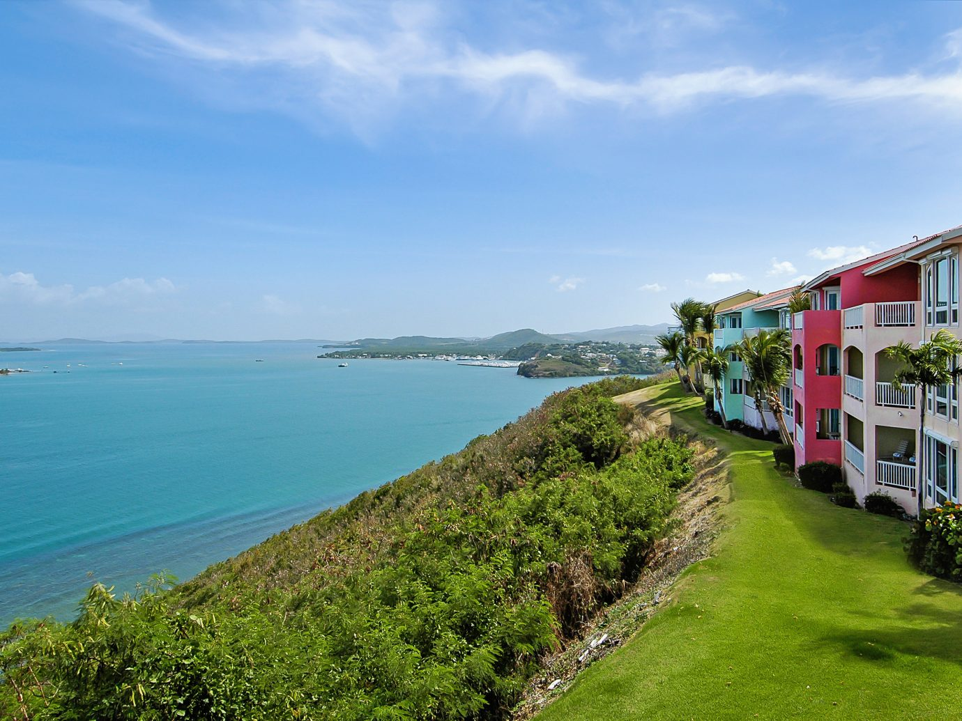 Hotels sky grass outdoor water Coast Sea landform geographical feature body of water shore Town vacation Beach Ocean bay Nature green tourism waterway cove cliff terrain Island cape grassy traveling lush hillside