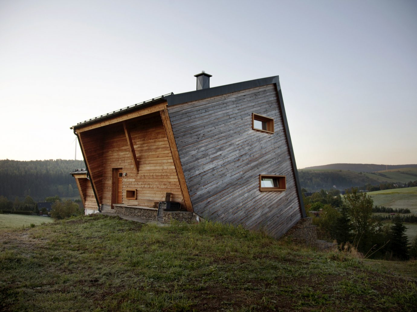 grass sky outdoor house building rural area fortification mountain shack barn