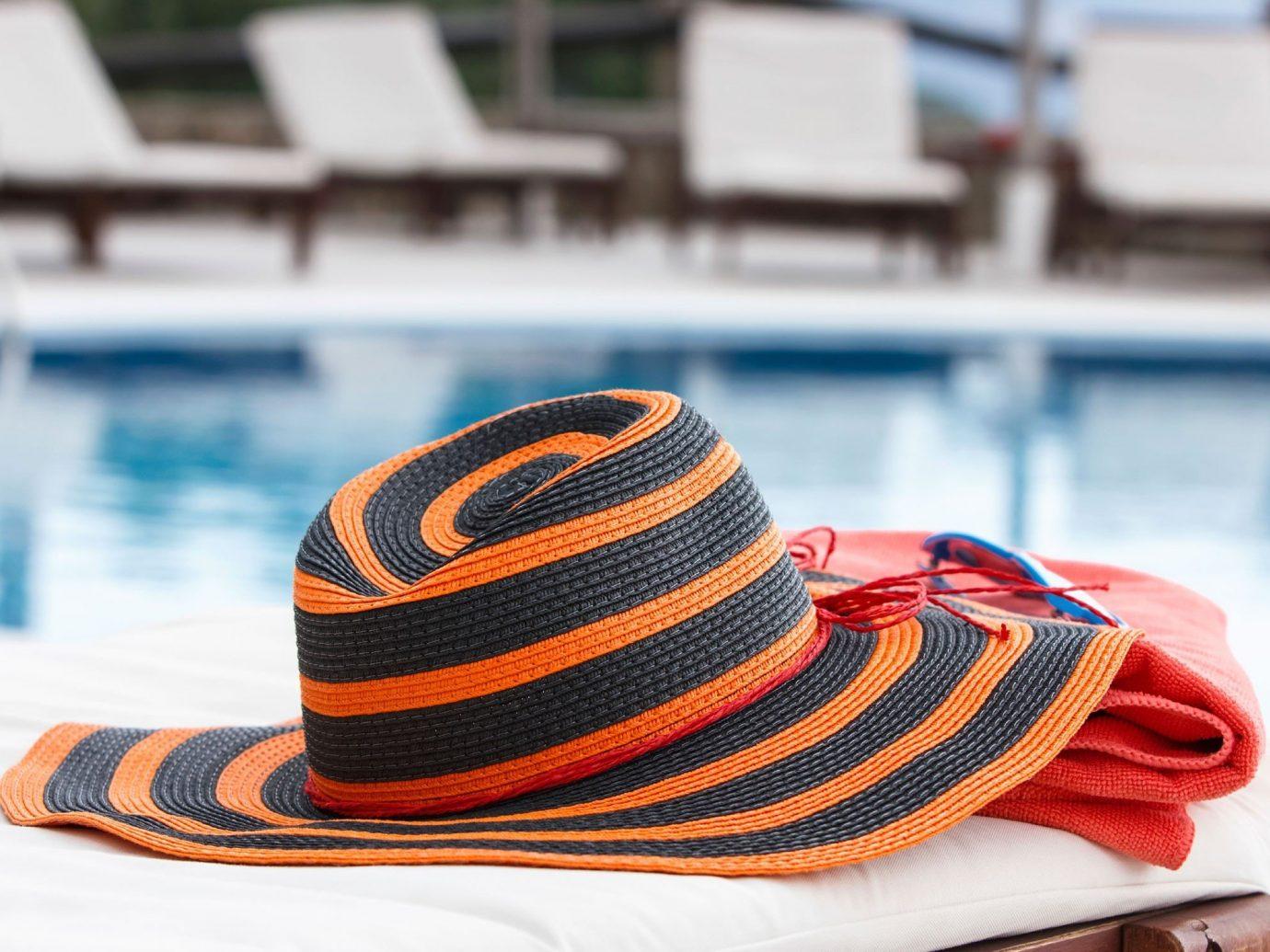 Hotels clothing outdoor person cap hat fashion accessory fedora headgear Design striped pattern orange