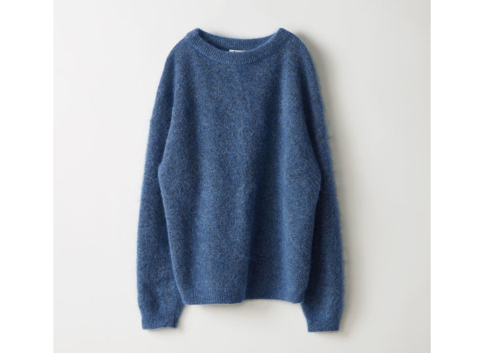Travel Shop Travel Tips clothing person indoor woolen neck sleeve sweater product electric blue pocket
