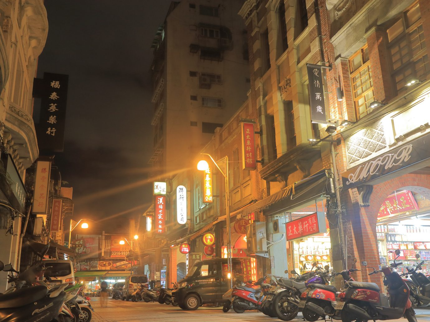 Arts + Culture Taipei Travel Tips Trip Ideas City metropolitan area landmark Town night street urban area Downtown metropolis neighbourhood building road evening alley cityscape window facade