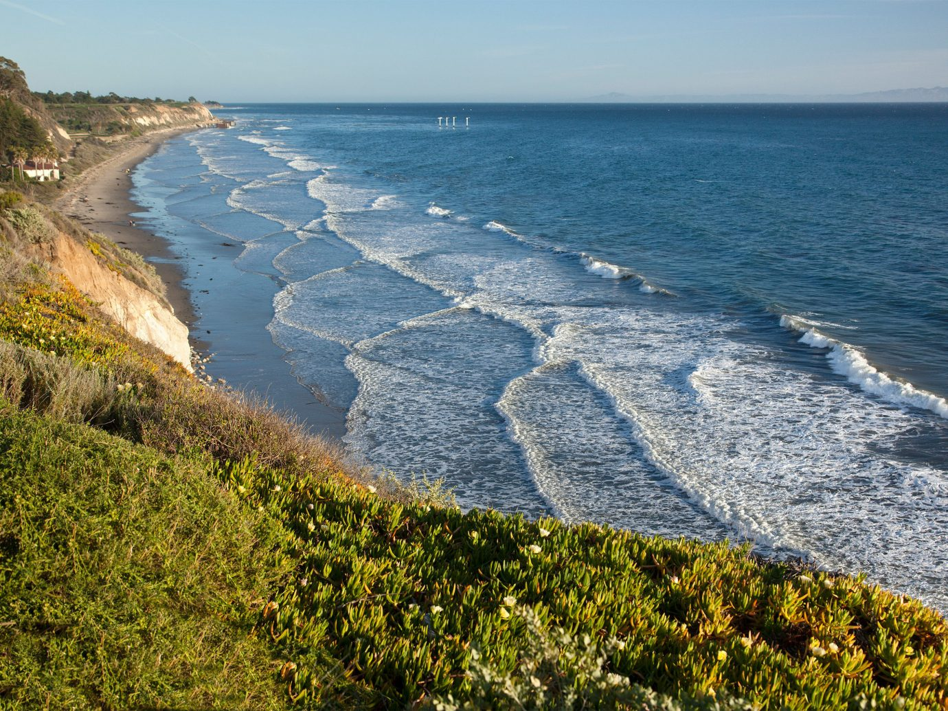 Hotels outdoor water sky grass habitat Coast Nature shore Sea landform body of water geographical feature Ocean horizon cliff Beach aerial photography vacation rock terrain cape bay wave landscape cove promontory distance
