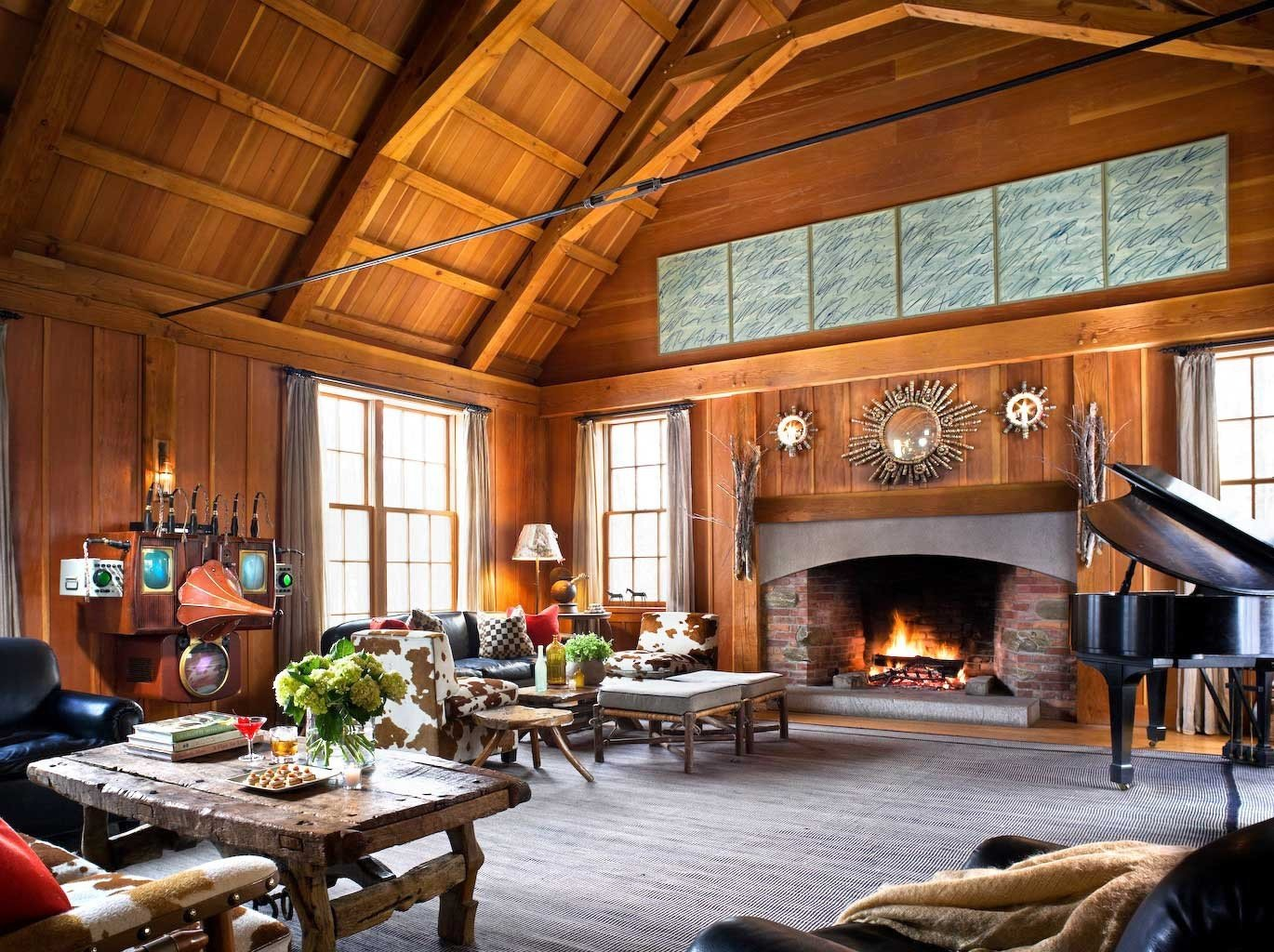 Hotels indoor Living room Fireplace ceiling fire building property living room estate home interior design wood log cabin cottage real estate furniture farmhouse recreation room area stone