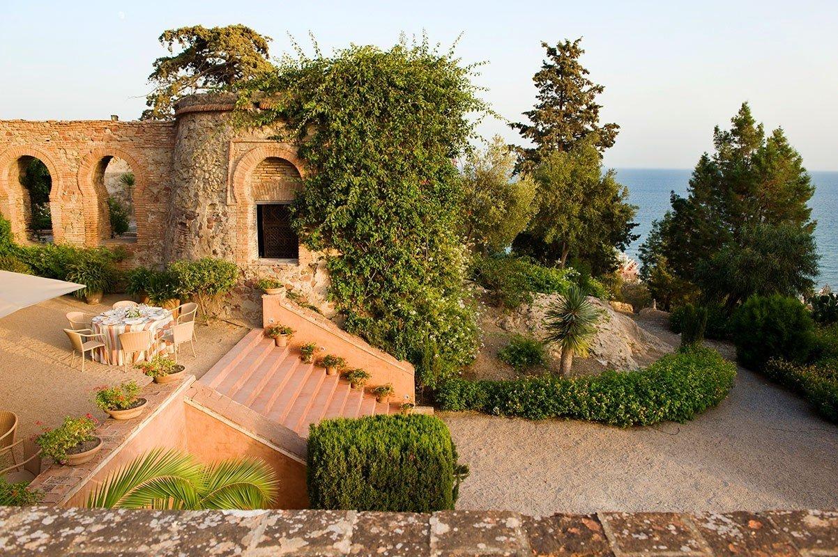 Hotels tree outdoor sky property estate Garden Courtyard stone Villa Village mansion hacienda yard