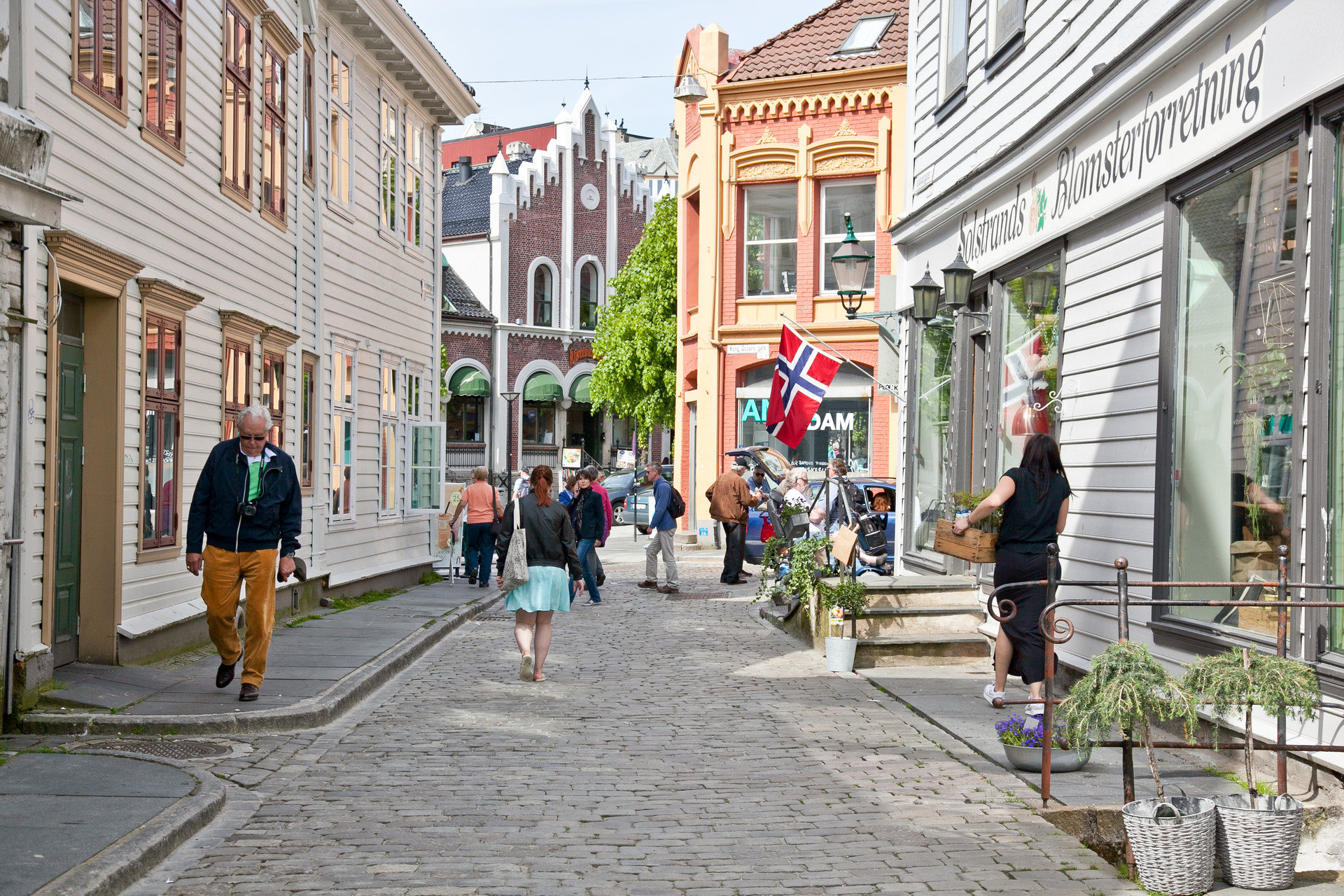 Architecture City city streets europe local streets people shopping Shops Trip Ideas walking building outdoor way scene road Town street neighbourhood sidewalk pedestrian lane human settlement walkway infrastructure Downtown plaza