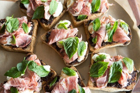 Food + Drink food dish prosciutto meat snack food hors d oeuvre canapé produce salt cured meat plant cuisine roast beef sandwich salad ham