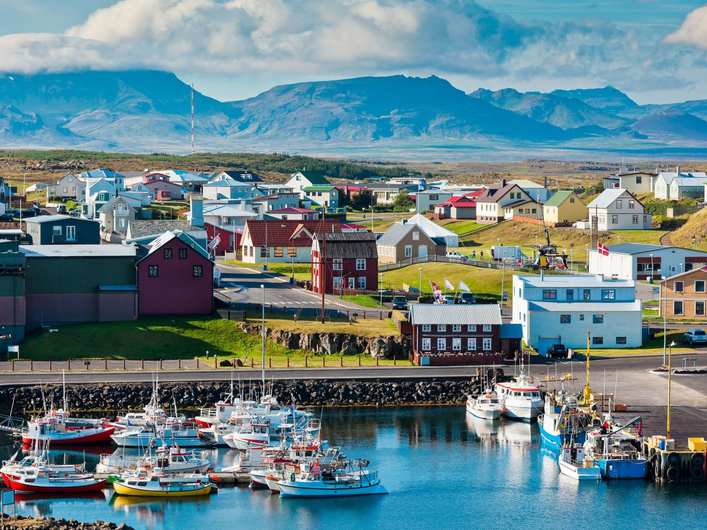 Iceland Travel Tips water sky scene Boat Harbor mountain outdoor Town Sea vacation vehicle tourism Coast passenger ship bay port boating cityscape cruise ship fjord marina dock