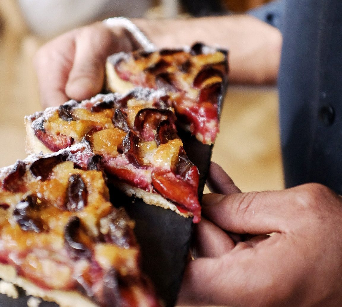 Food + Drink person pizza indoor food cuisine dish piece slice italian food european food sushi close