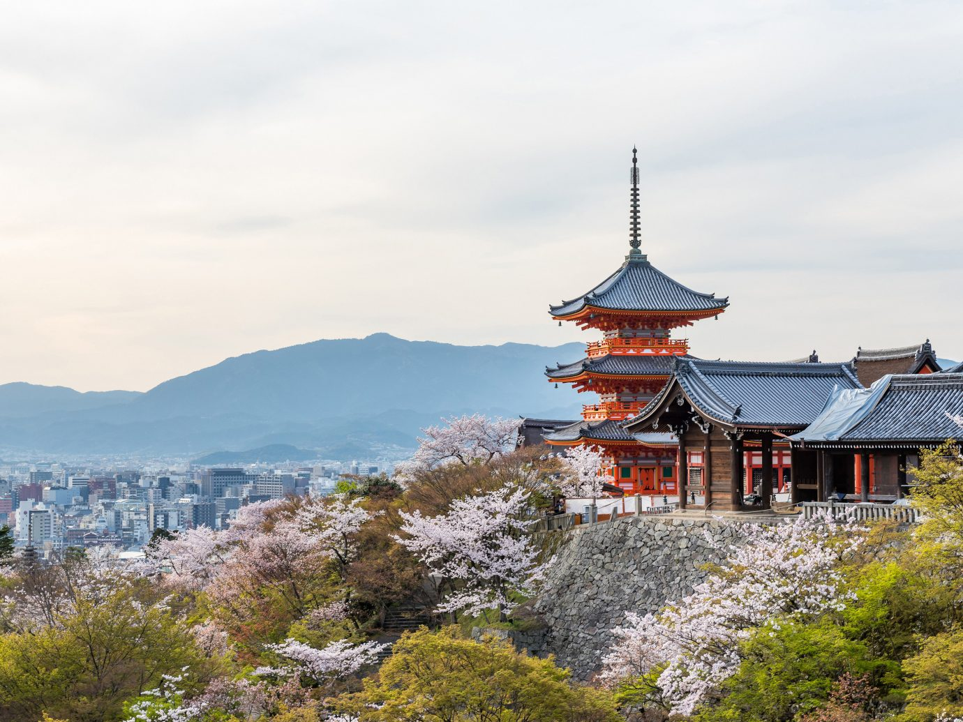 Japan Trip Ideas sky mountainous landforms plant landmark mountain tree tourist attraction mountain range cloud mount scenery hill station City spring cherry blossom tourism building alps roof landscape