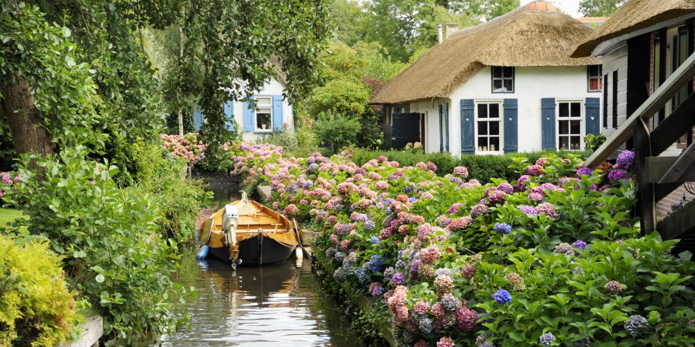 Trip Ideas tree outdoor house water geographical feature flower Canal waterway River Village Garden cottage estate surrounded Town