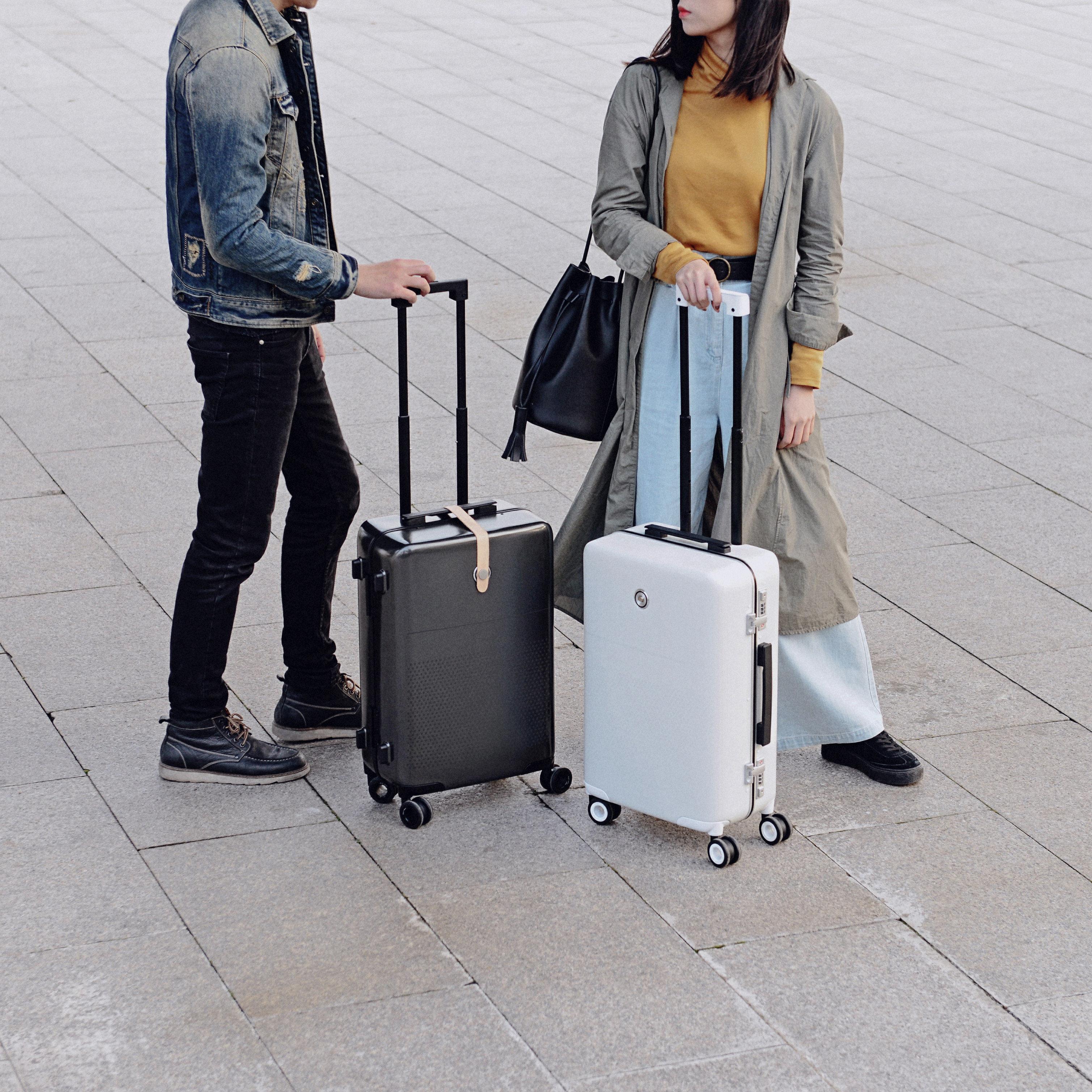 Celebs Style + Design Travel Shop ground outdoor person standing suitcase sidewalk way flooring