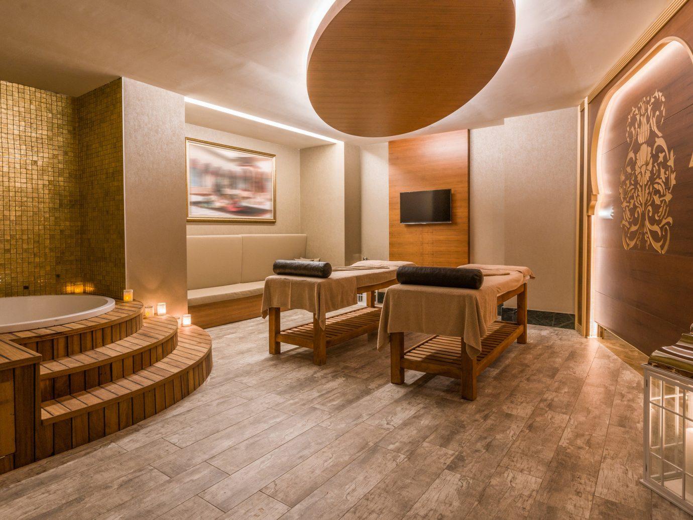 Health + Wellness Trip Ideas indoor wall floor ceiling room interior design Lobby flooring Suite real estate wood wood flooring estate interior designer hall furniture