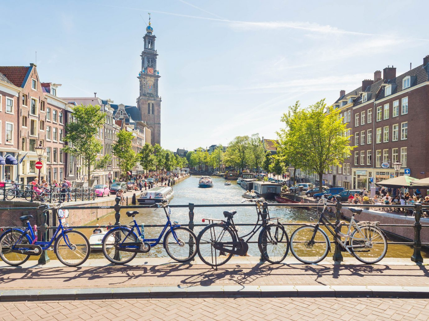 Lakes + Rivers Landmarks Travel Tips outdoor sky bicycle building waterway land vehicle body of water Town Canal lane City road bicycle urban area water cycling tree street parked metropolitan area Downtown recreation vehicle plant River town square road channel tours