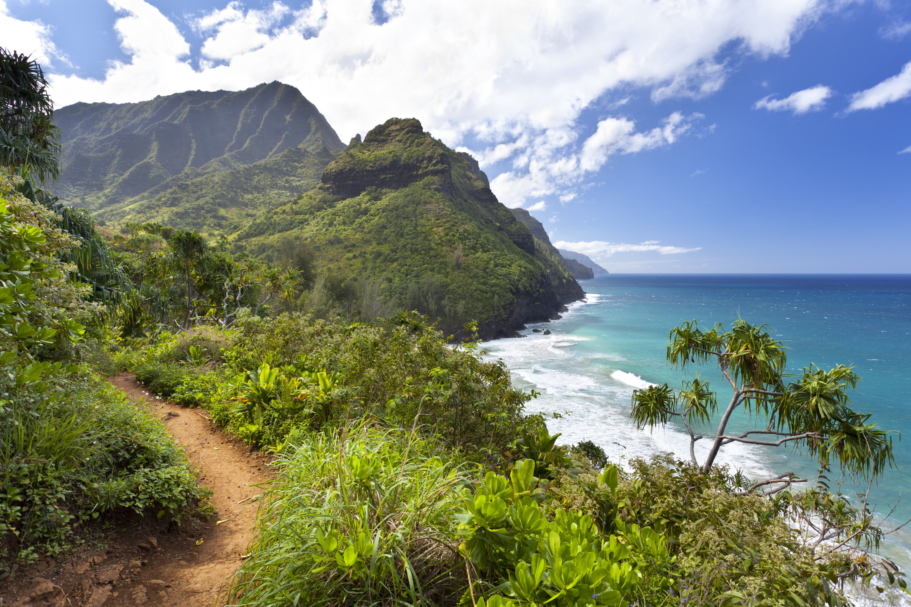 Health + Wellness Travel Tips Trip Ideas outdoor mountain sky water Nature geographical feature landform Coast body of water River Sea vacation Ocean cliff path landscape bay terrain Beach cape tropics hillside overlooking bushes