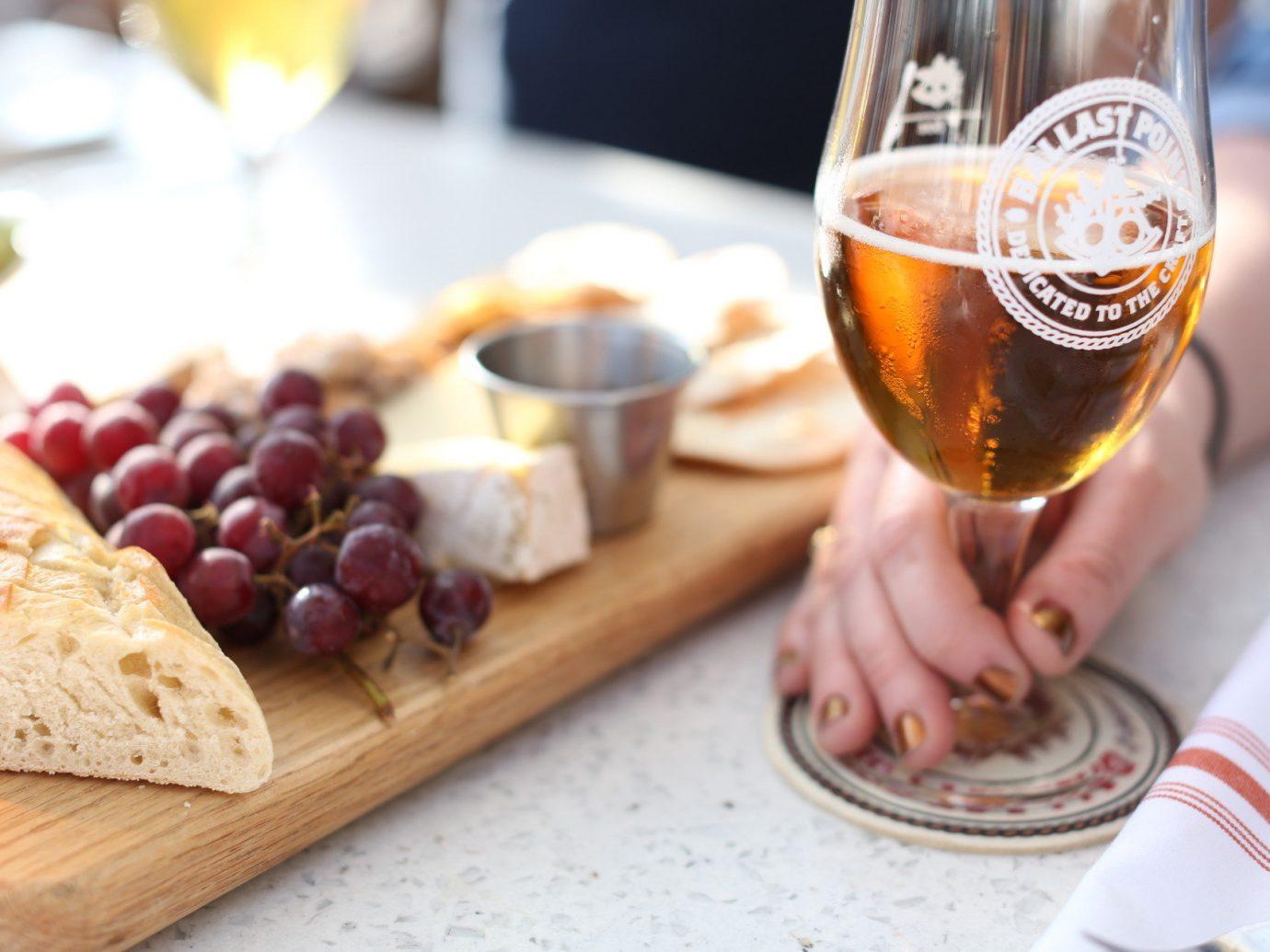 Jetsetter Guides table food Drink alcoholic beverage brunch appetizer stemware wine glass wine wooden liqueur beer breakfast cuisine recipe bread
