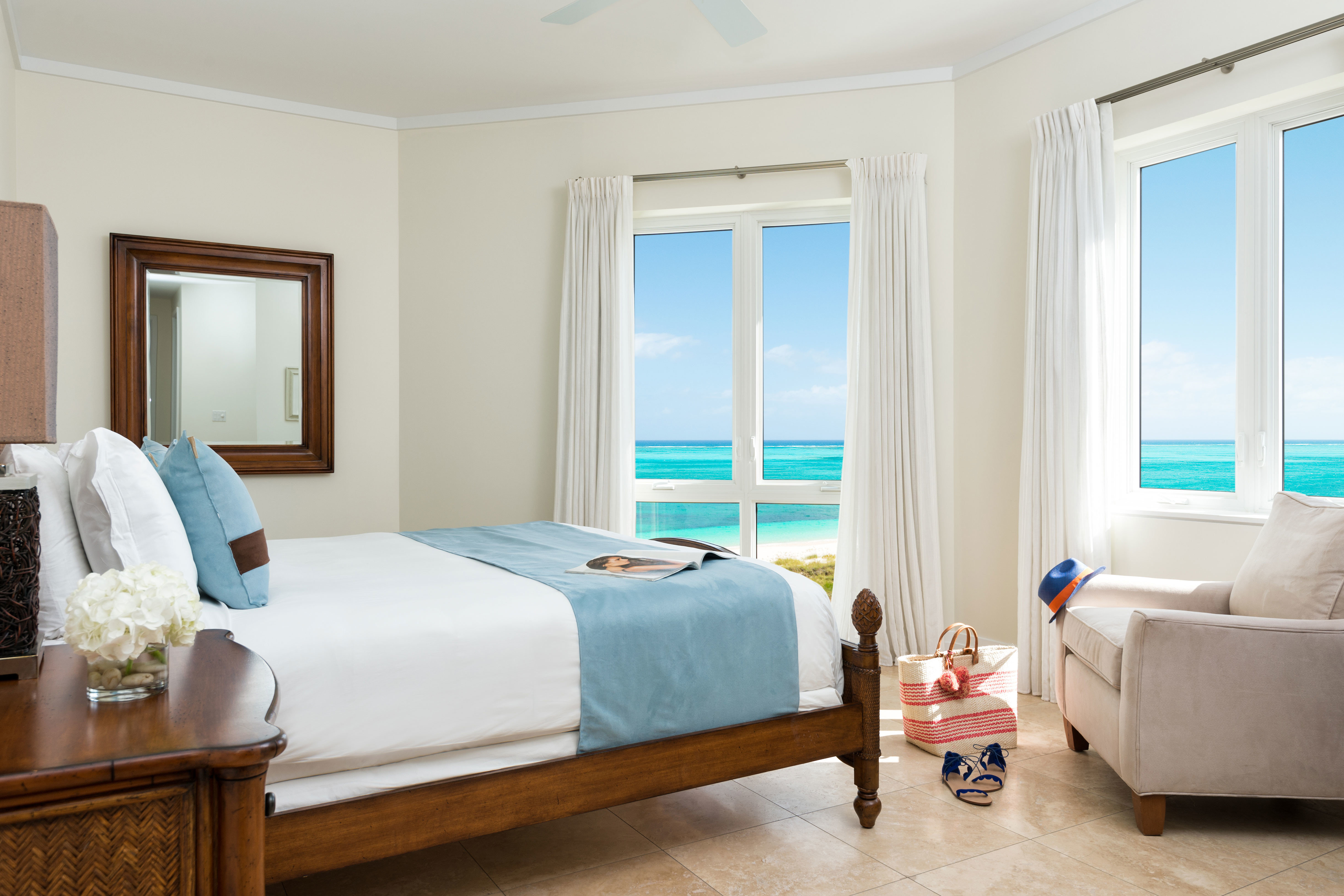 Beachfront Bedroom Family Hotels Living indoor floor wall window sofa room property furniture ceiling Suite hotel estate real estate interior design home cottage living room apartment bed decorated flat Modern
