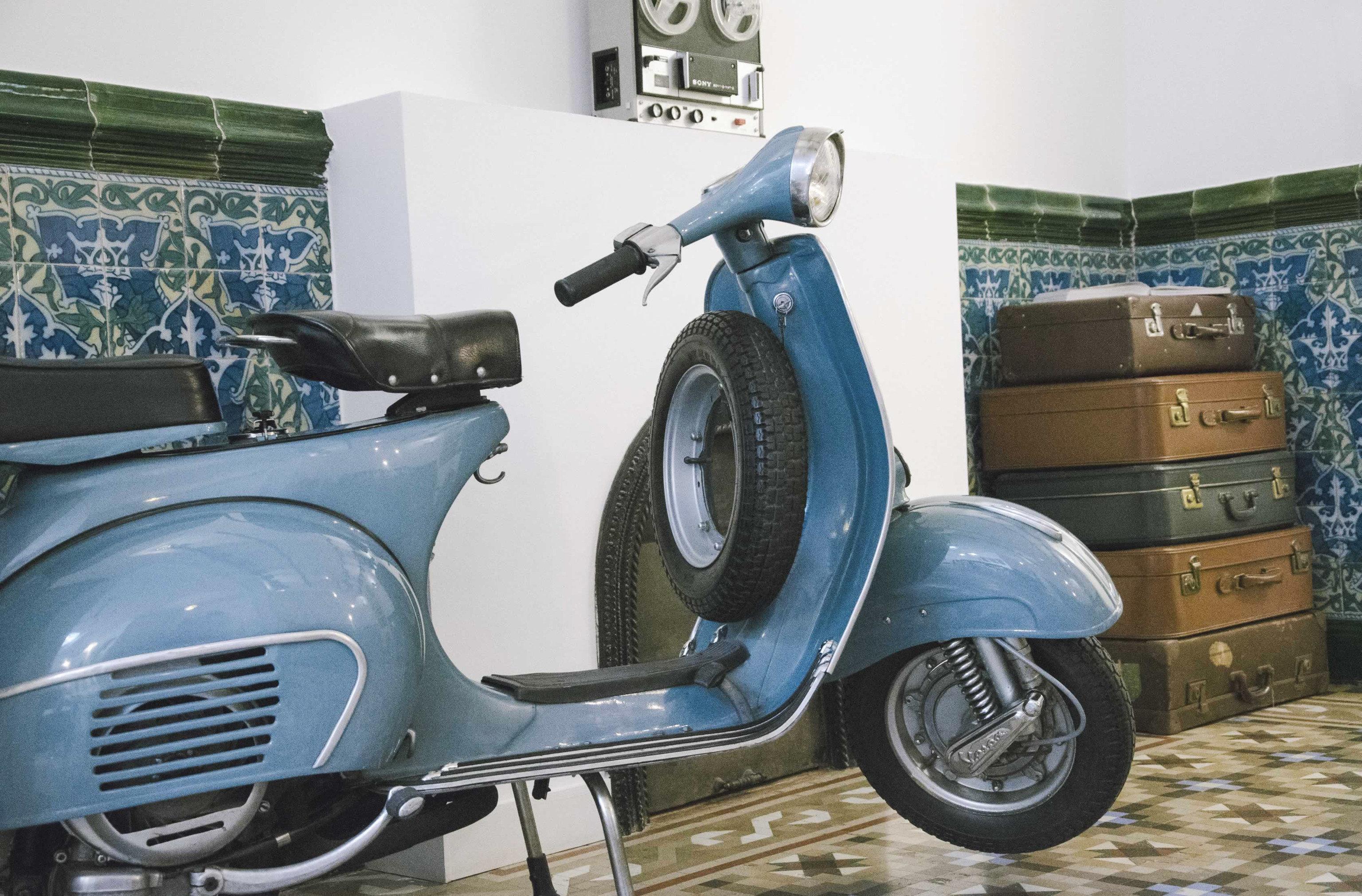 Hotels scooter vespa car indoor parked automotive design motorcycle vehicle blue automobile make seat tiled