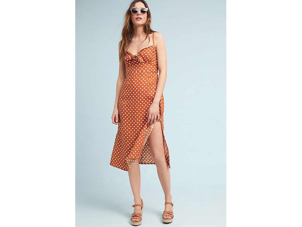 City Palm Springs Style + Design Travel Shop clothing woman fashion model person day dress dress shoulder orange standing posing joint pattern Design supermodel neck fashion design peach cocktail dress cover up lady female beautiful