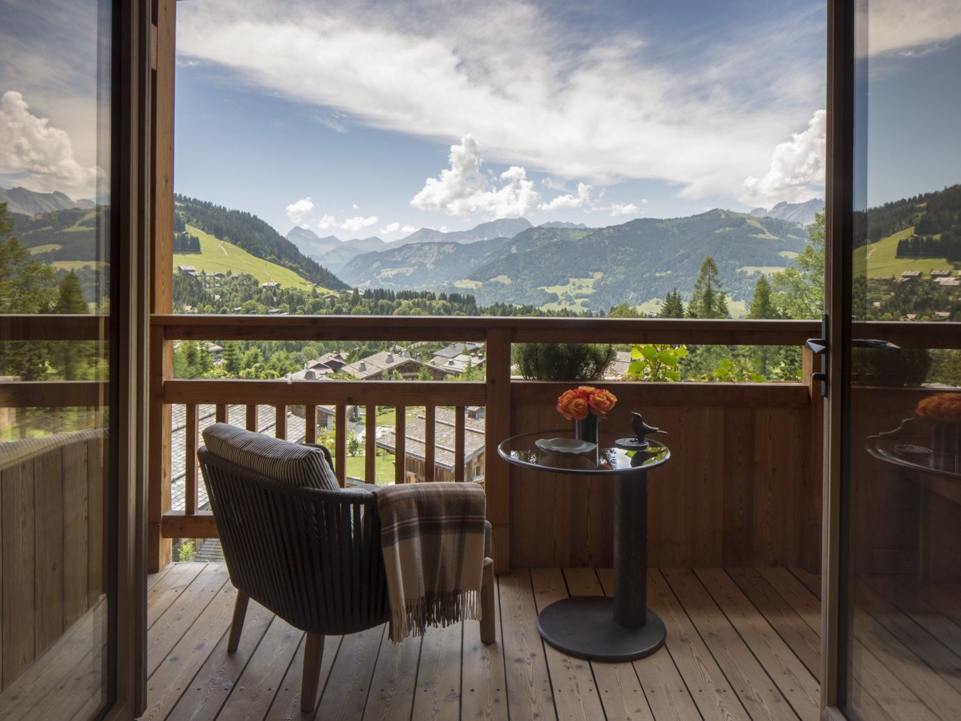 Boutique Hotels Hotels Outdoors + Adventure Winter window sky mountain property real estate home apartment Balcony house estate interior design tree penthouse apartment overlooking day