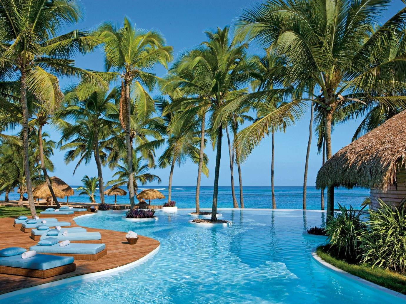 All-inclusive Beach Hotels Luxury Pool Resort Scenic views Waterfront tree outdoor water sky palm swimming pool property caribbean vacation plant estate arecales tropics Sea Lagoon lined palm family bay swimming blue surrounded
