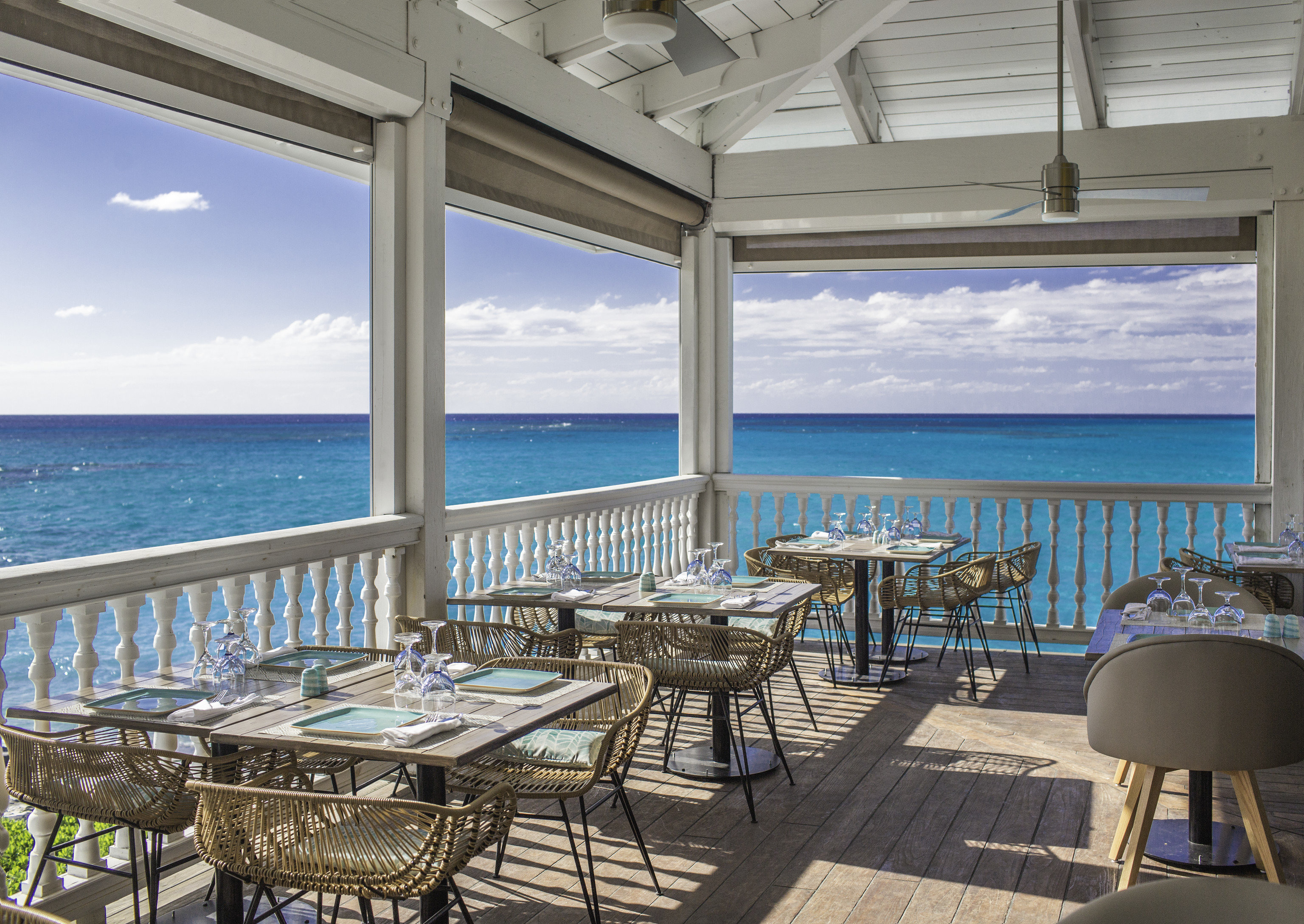 All-Inclusive Resorts caribbean Family Travel Hotels Sea sky real estate Resort apartment water vacation condominium penthouse apartment window outdoor structure interior design Ocean restaurant roof