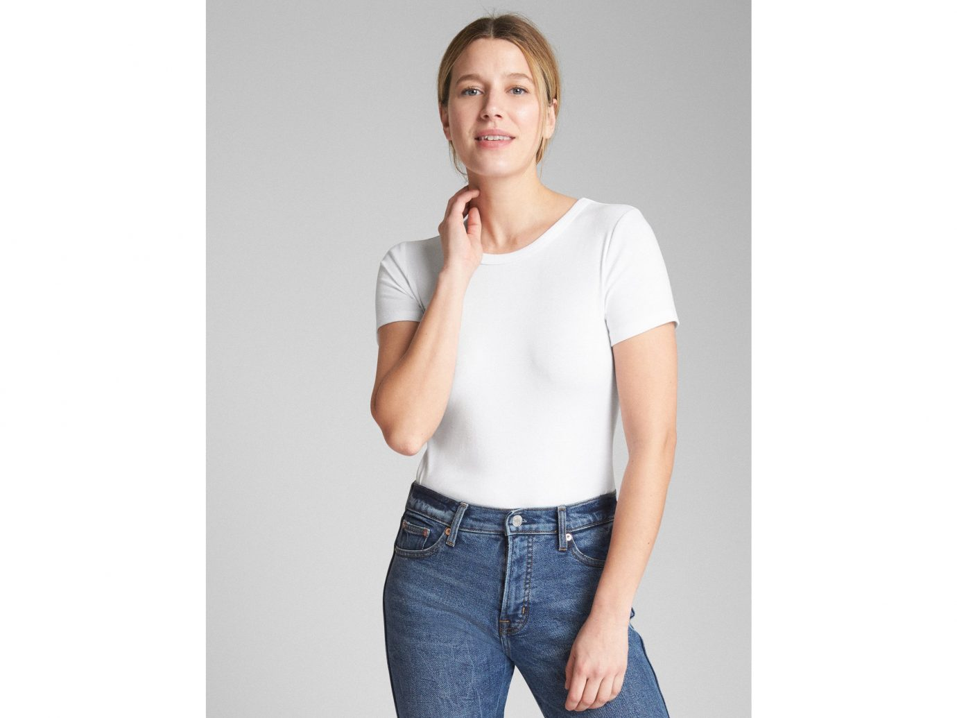 Spring Travel Style + Design Summer Travel Travel Lifestyle Travel Shop person wall clothing white indoor standing shoulder posing t shirt sleeve neck joint fashion model muscle jeans waist trouser