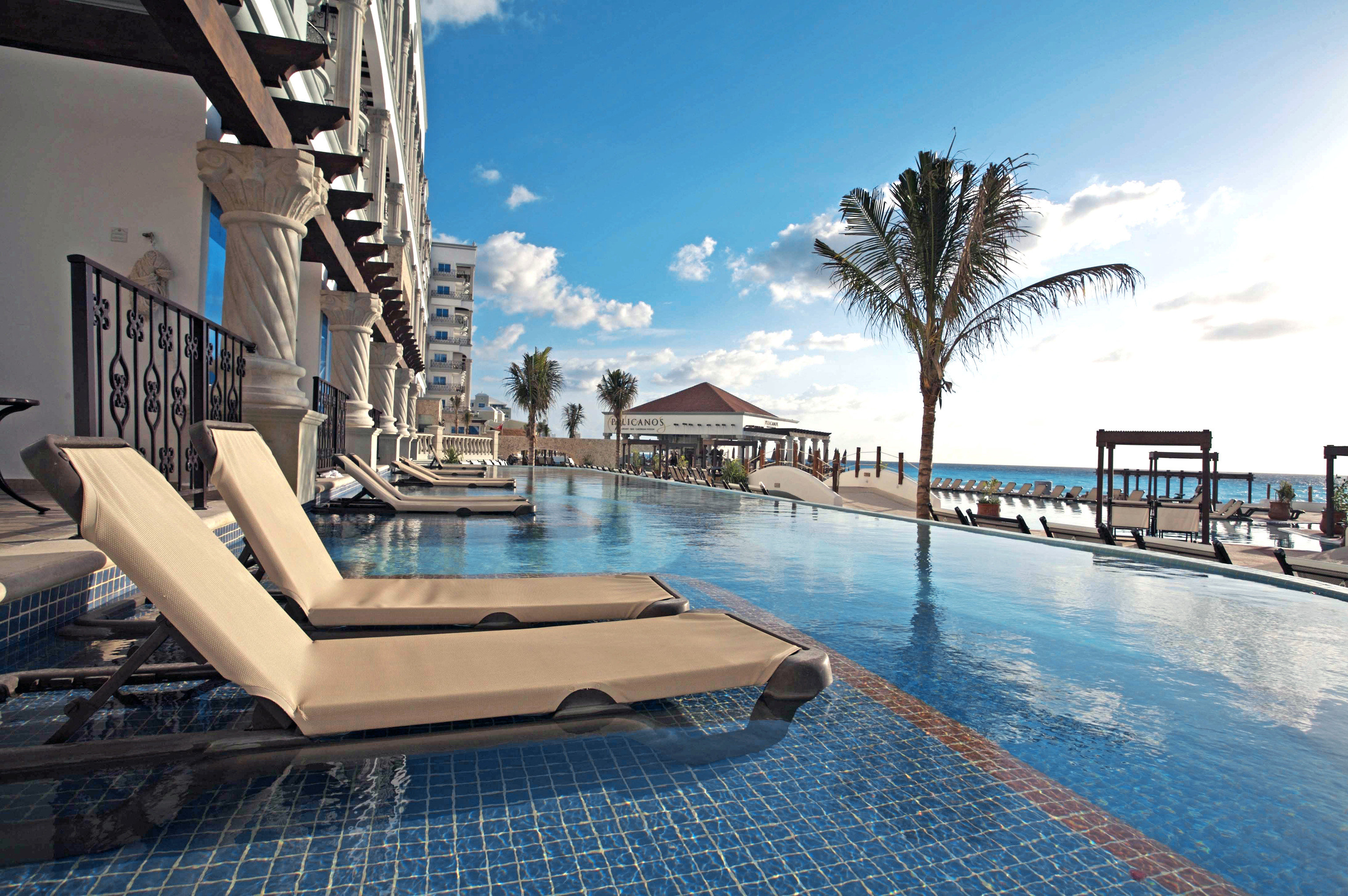 Adult-only All-Inclusive Resorts Cancun Hotels Mexico sky outdoor swimming pool property Resort leisure water real estate condominium vacation estate hotel resort town Sea apartment penthouse apartment amenity tourism day